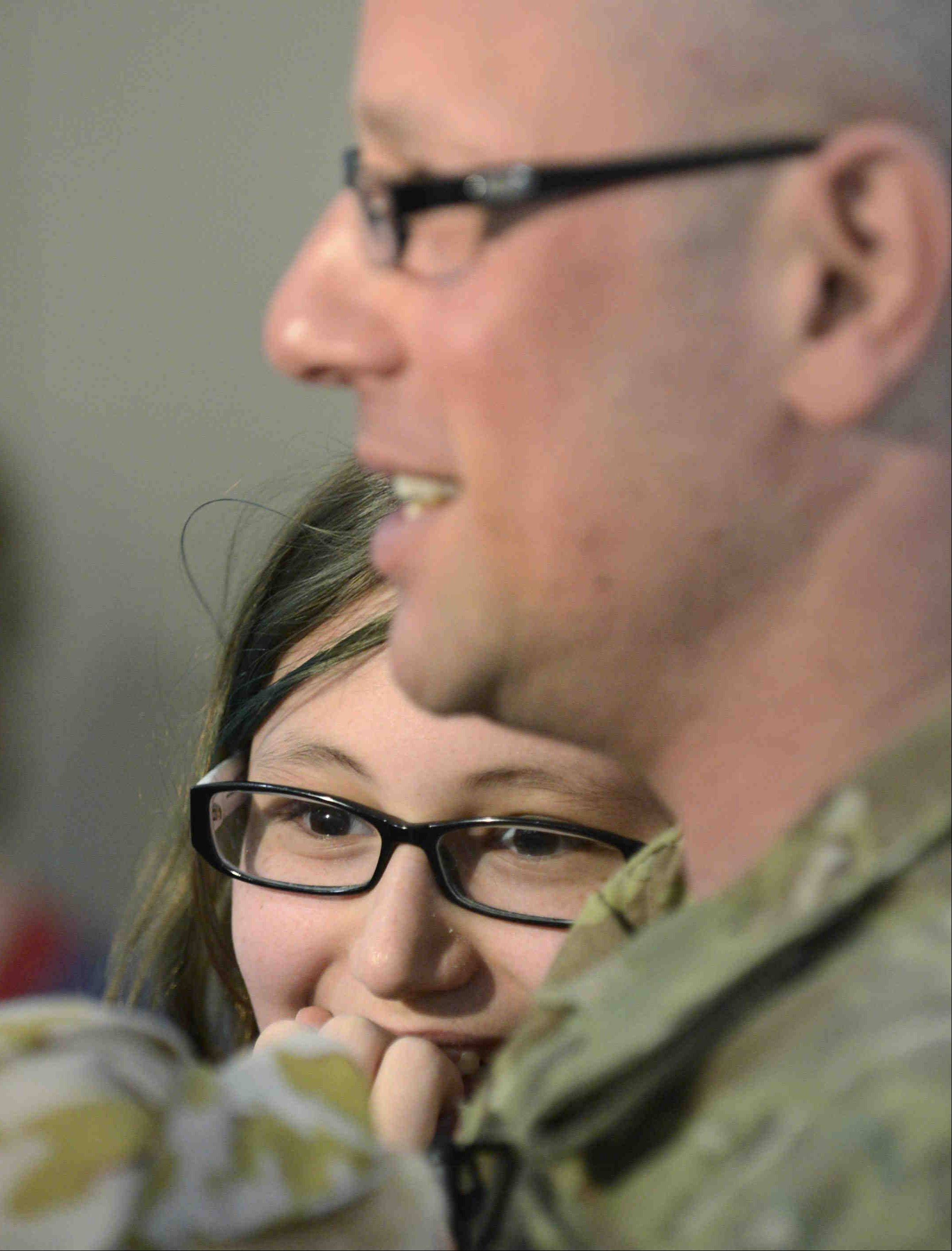 Lt. Jordon Wolf and daughter Kayla, 11, had a surprise reunion Thursday at a Streamwood school.