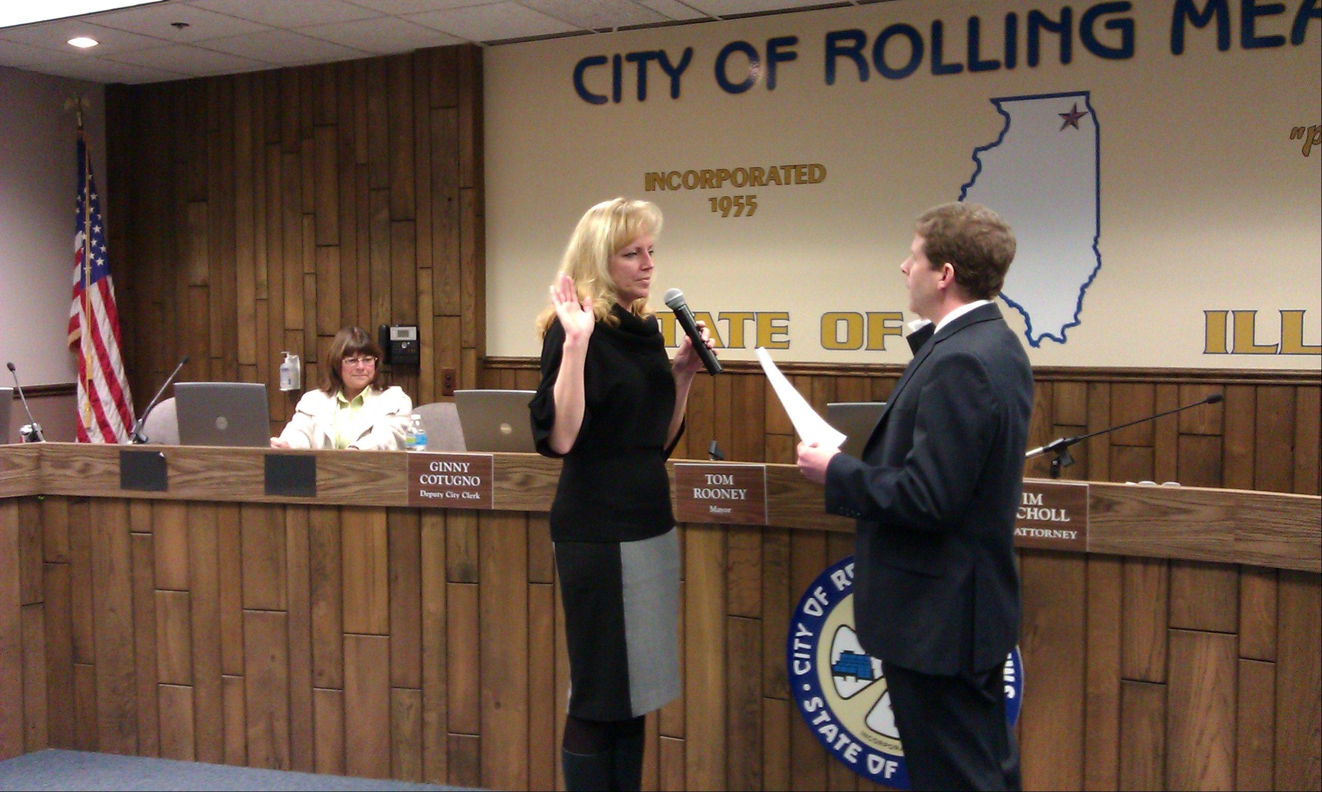 Laura Majikes takes the oath of office Tuesday as she was appointed as Rolling Meadows 3rd Ward alderman. Majikes is filling the seat left vacant after the death of former Alderman Larry Buske in December.