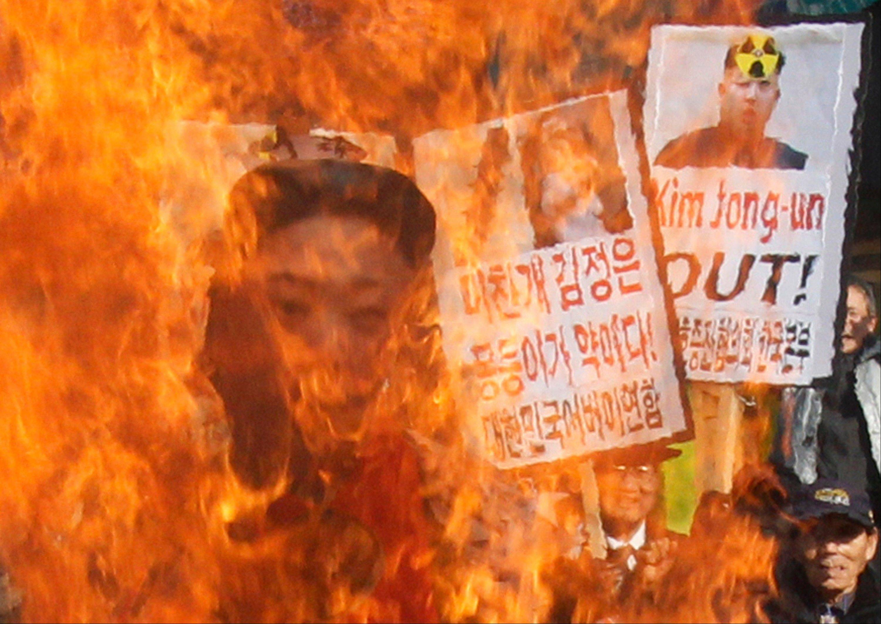 South Korean protesters burn an effigy of North Korean leader Kim Jong Un during an anti-North Korea rally denouncing the North's nuclear test in Seoul, South Korea, Wednesday, Feb. 13, 2013.