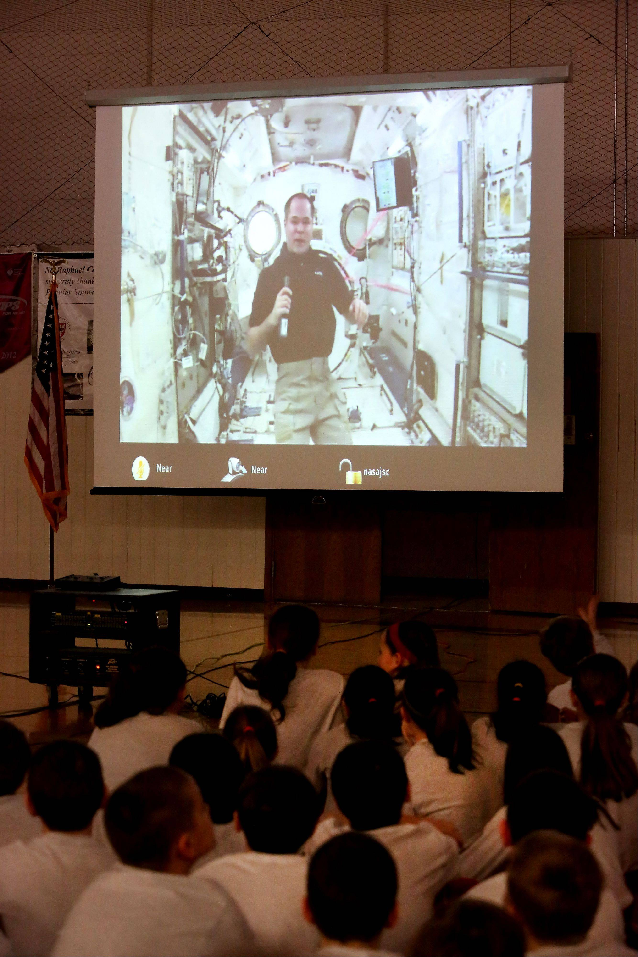 Students from St. Raphael School in Naperville on Tuesday talked to Cmdr. Kevin Ford aboard the International Space Station. Ford, however, was unable to see the students.