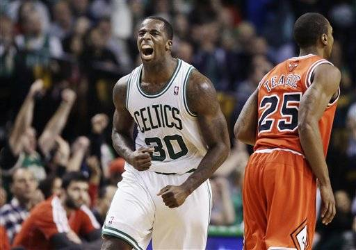 -- Kevin Garnett scored eight of his 12 points in the fourth quarter and added 11 rebounds, and the Boston Celtics overcame poor shooting to beat the Bulls 71-69 Wednesday night.