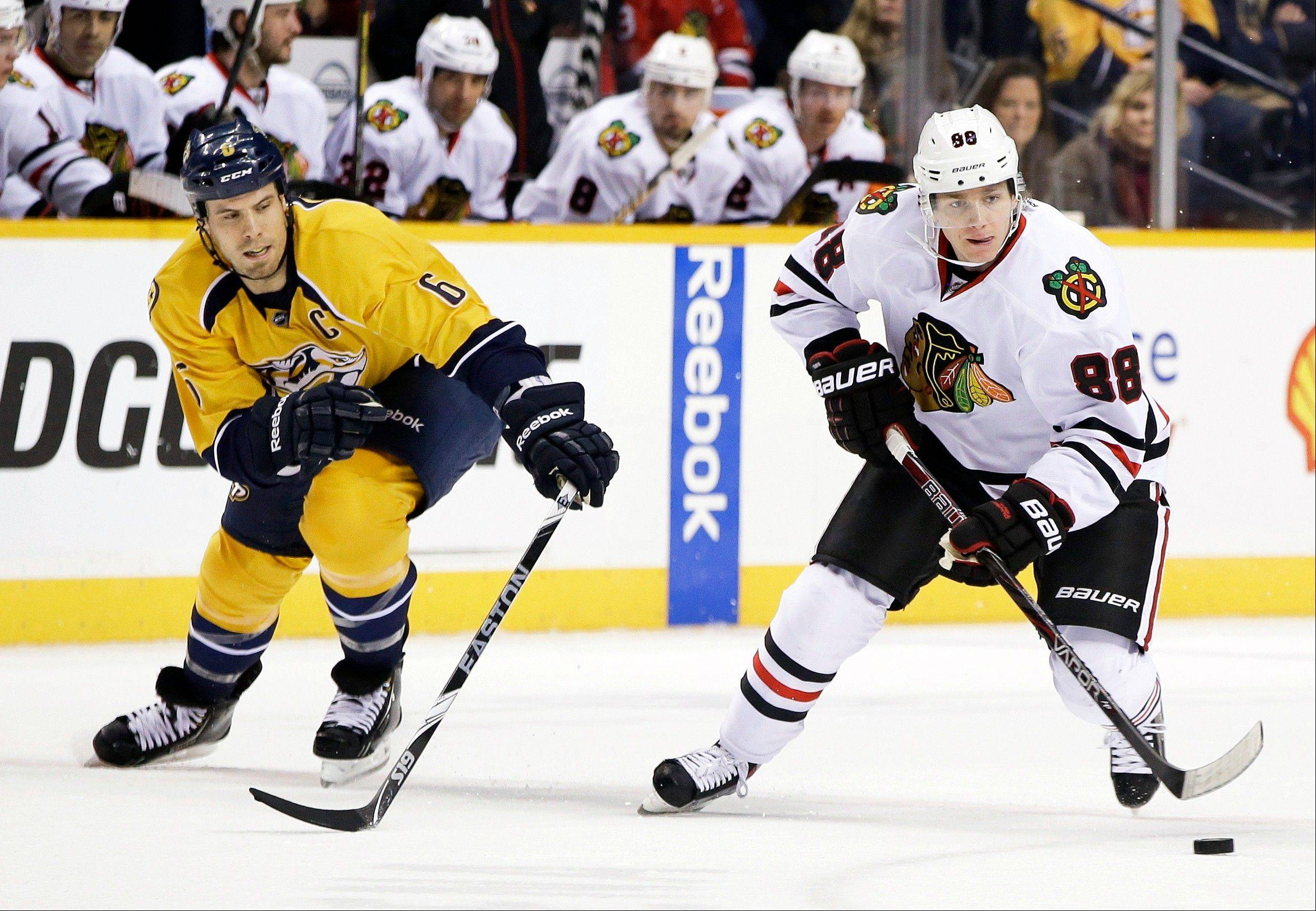 The Blackhawks' Patrick Kane, here moving past Nashville's Shea Weber, has 20 points in the first 13 games.