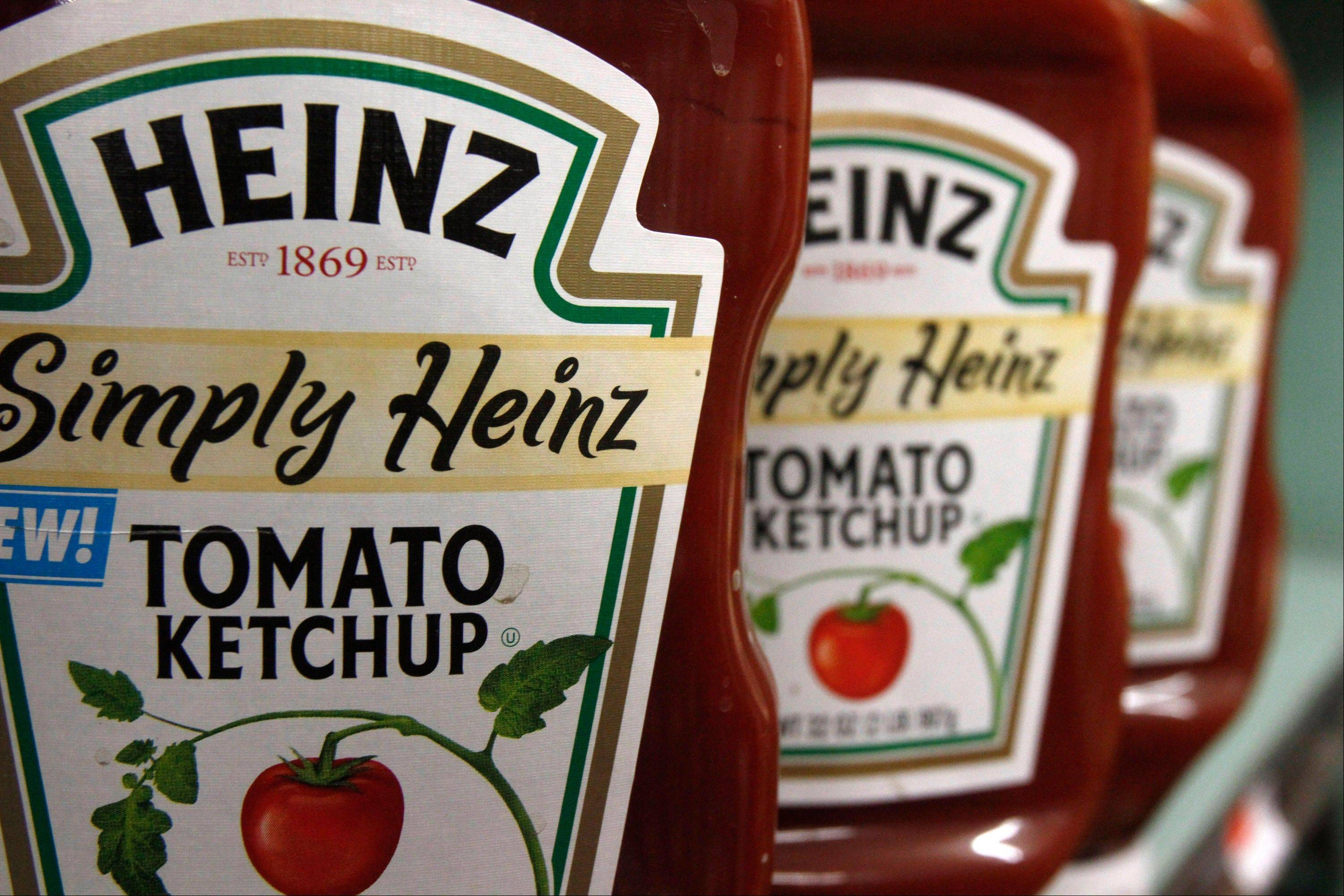 Billionaire investor Warren Buffett is dipping into the ketchup business as part of $23.3 billion deal to buy the Heinz ketchup company.