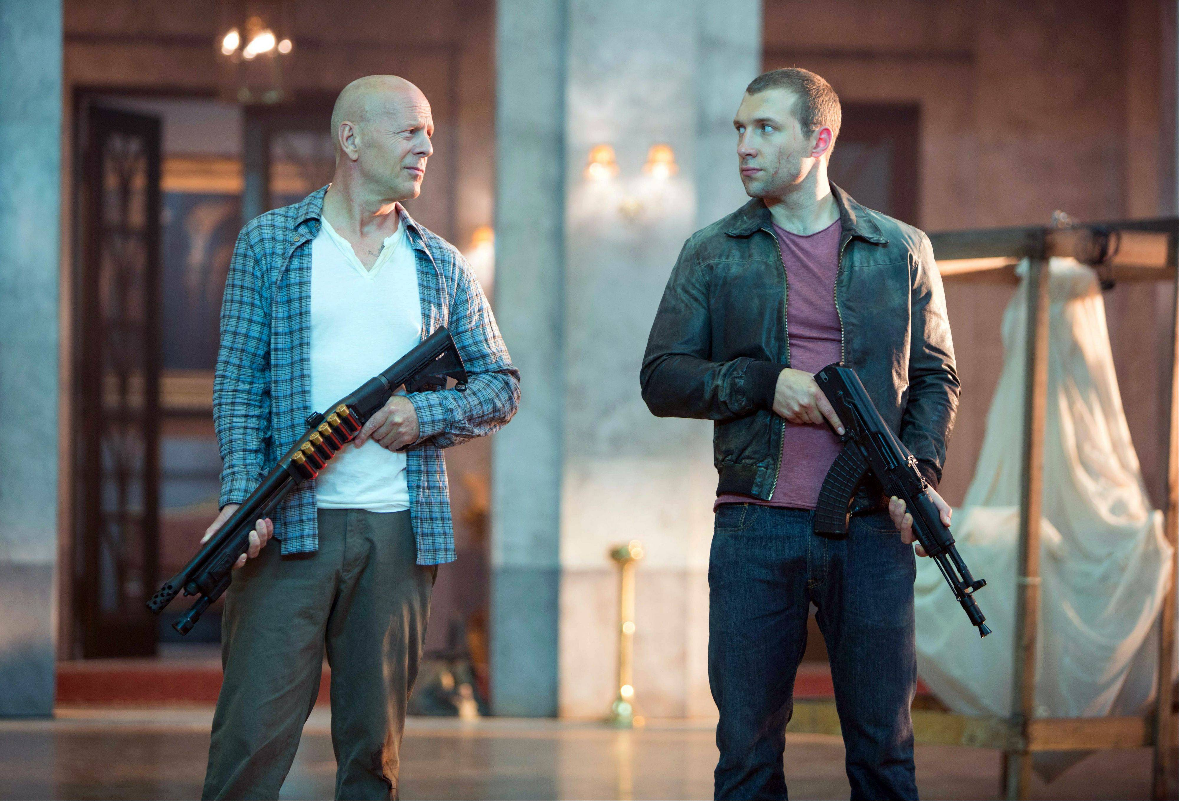 "John McClane (Bruce Willis), left, teams up with his son Jack (Jai Courtney) to take on Russian mobsters in ""A Good Day to Die Hard."""