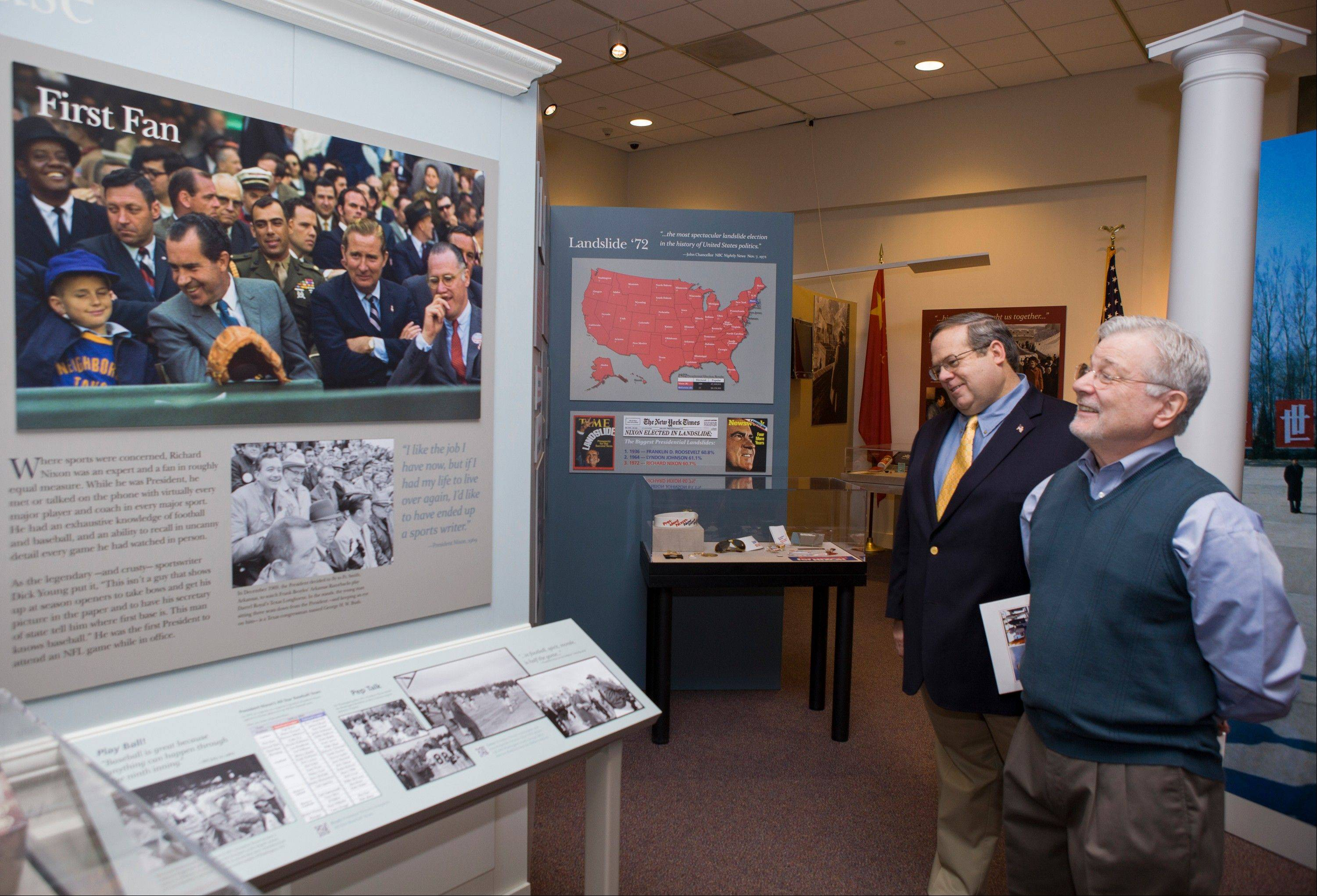 Curator Bob Bostock, a former Nixon aide who designed the original Watergate exhibit, left, and co-curator Frank Gannon, tour �Patriot. President. Peacemaker,� a new special exhibit opening Feb. 15 at the Richard Nixon Presidential Library and Museum in Yorba Linda, Calif.