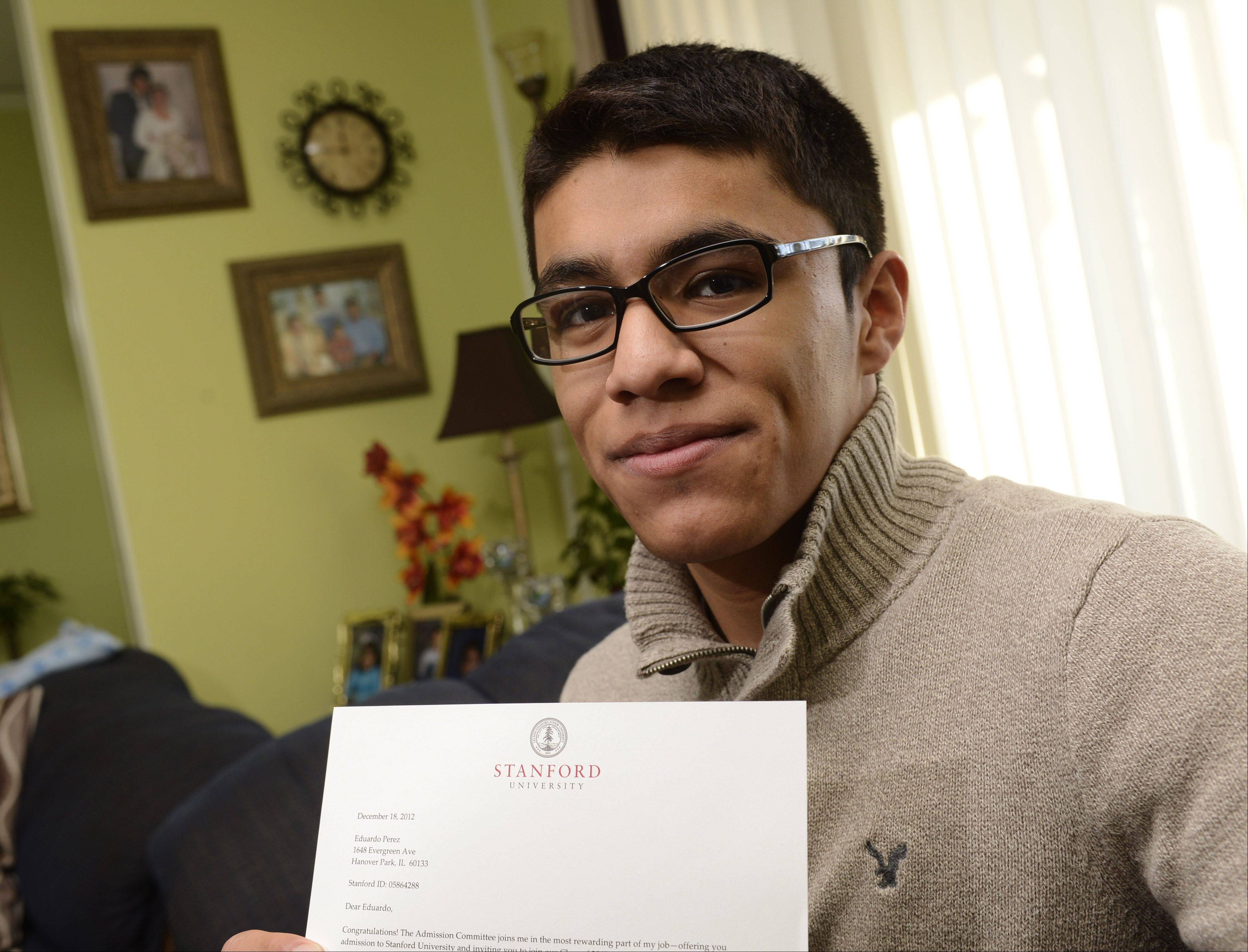 Eduardo Perez of Hanover Park, a senior at Elgin High School, has accepted a four-year scholarship to Stanford University. Here he's pictured with his acceptance letter. Eduardo is on the varsity track, swim and soccer teams.