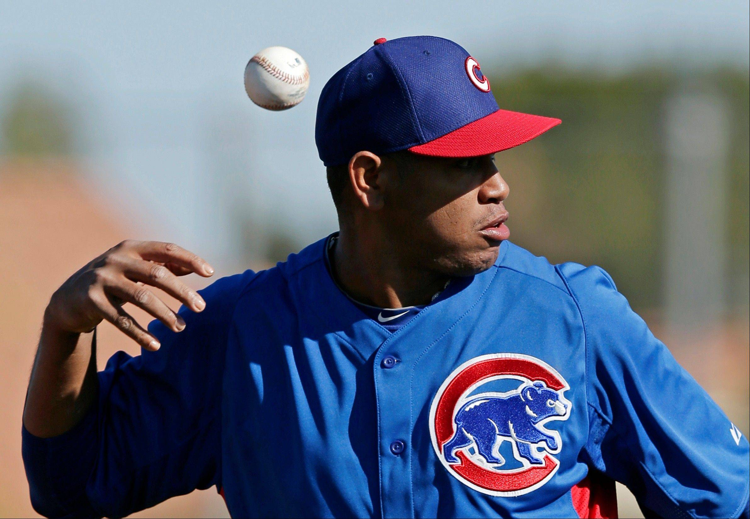 Chicago Cubs' Carlos Marmol loses the grip on a ball during a baseball spring training workout Thursday, Feb. 14, 2013, in Mesa, Ariz. (AP Photo/Morry Gash)