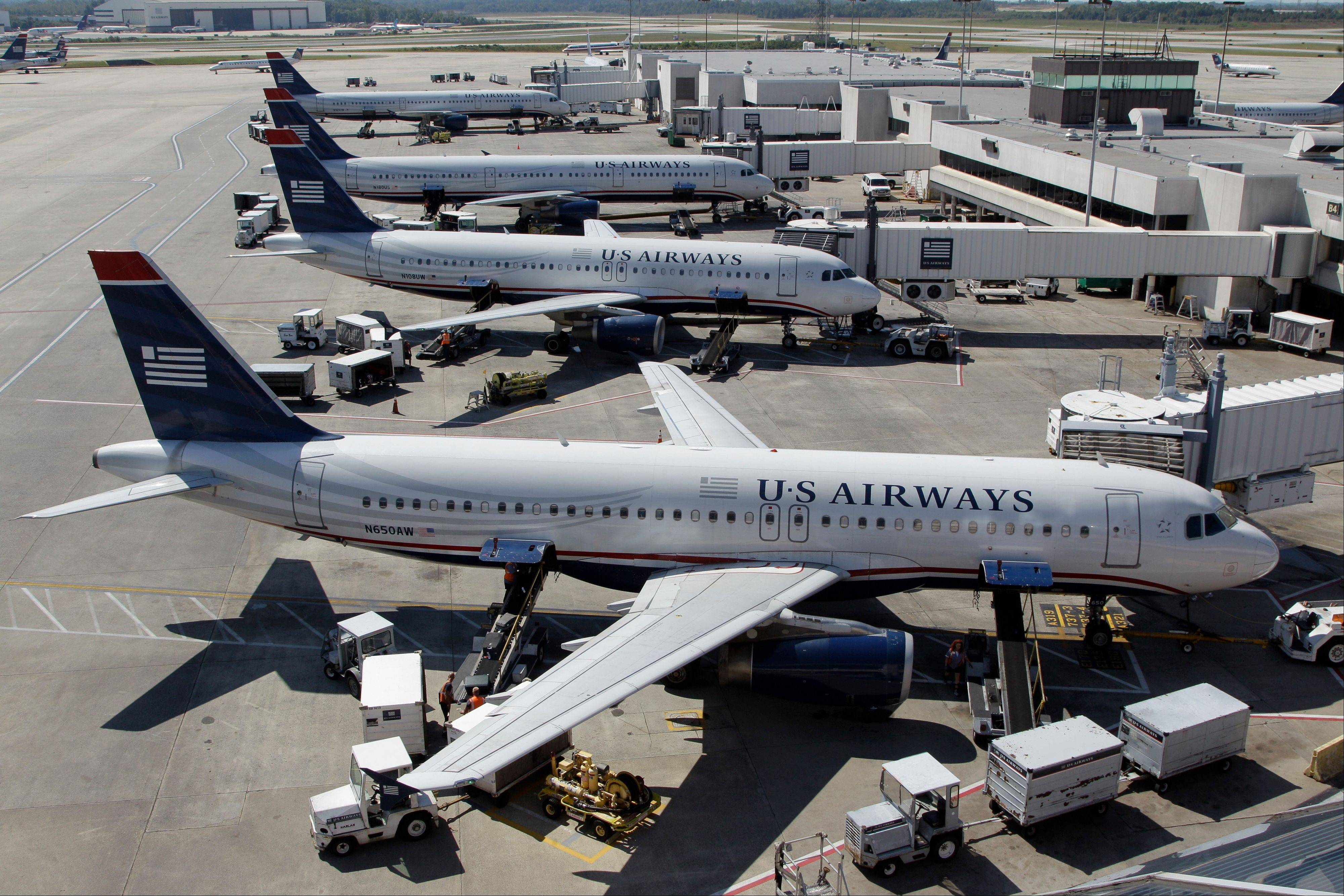 US Airways jets parked at their gates at the Charlotte/Douglas International airport in Charlotte, N.C.