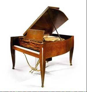 An art deco grand piano that sailed aboard the French ocean liner Normandie in the 1930s and spent decades inside a Buffalo mansion is up for auction.