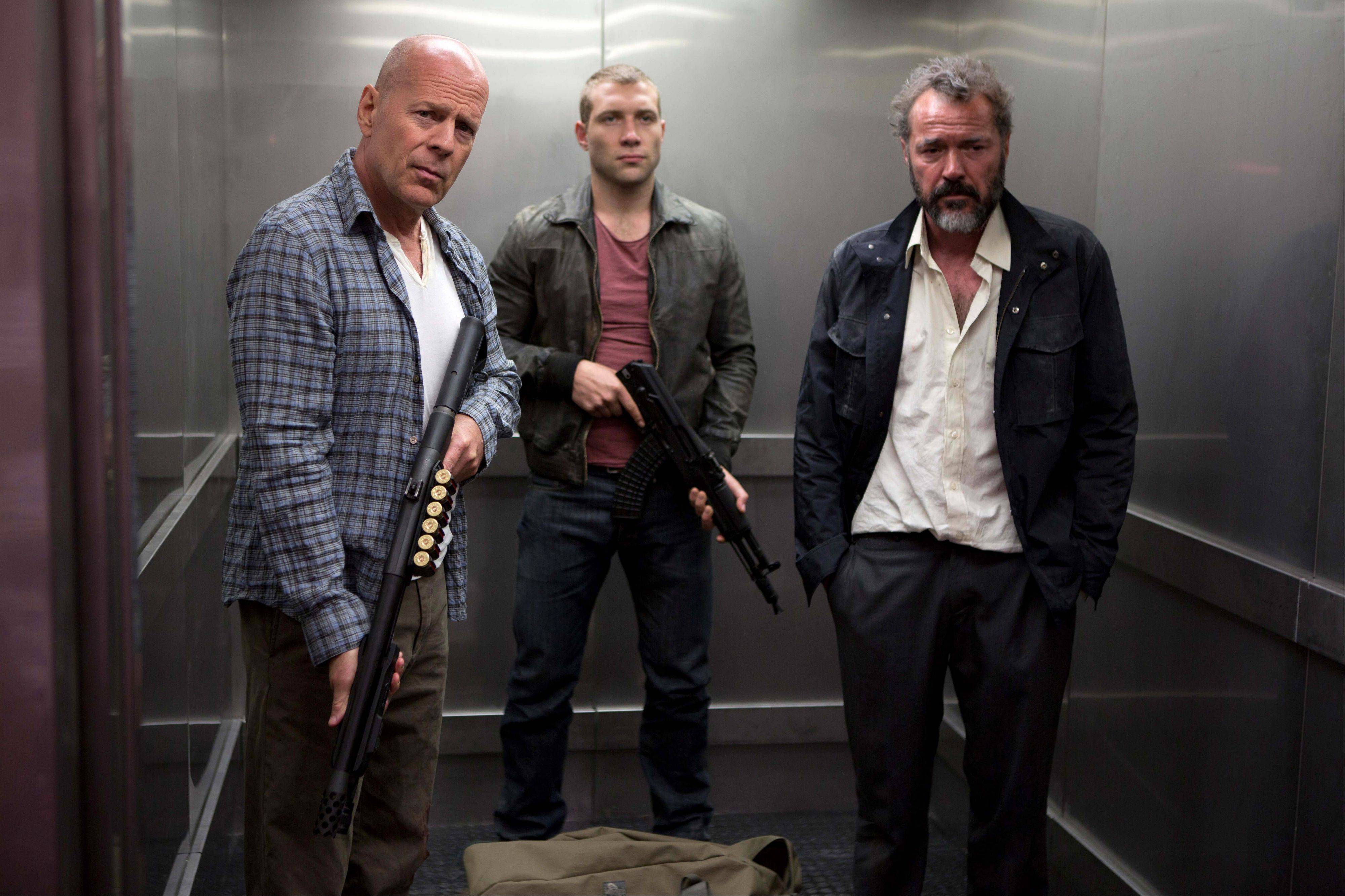 "John McClane (Bruce Willis), left, teams up with his son Jack (Jai Courtney) to protect a mob witness (Sebastian Koch), right, in ""A Good Day to Die Hard."""