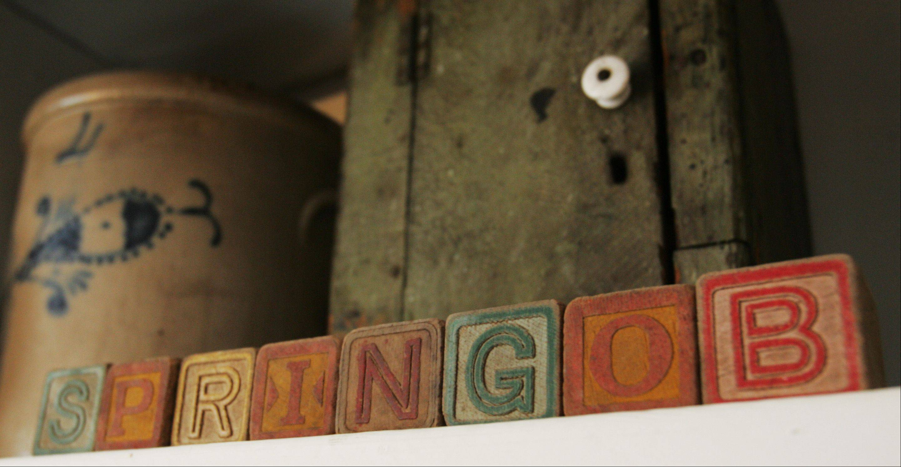 Antique toy blocks spell out the couple's last name on a shelf.