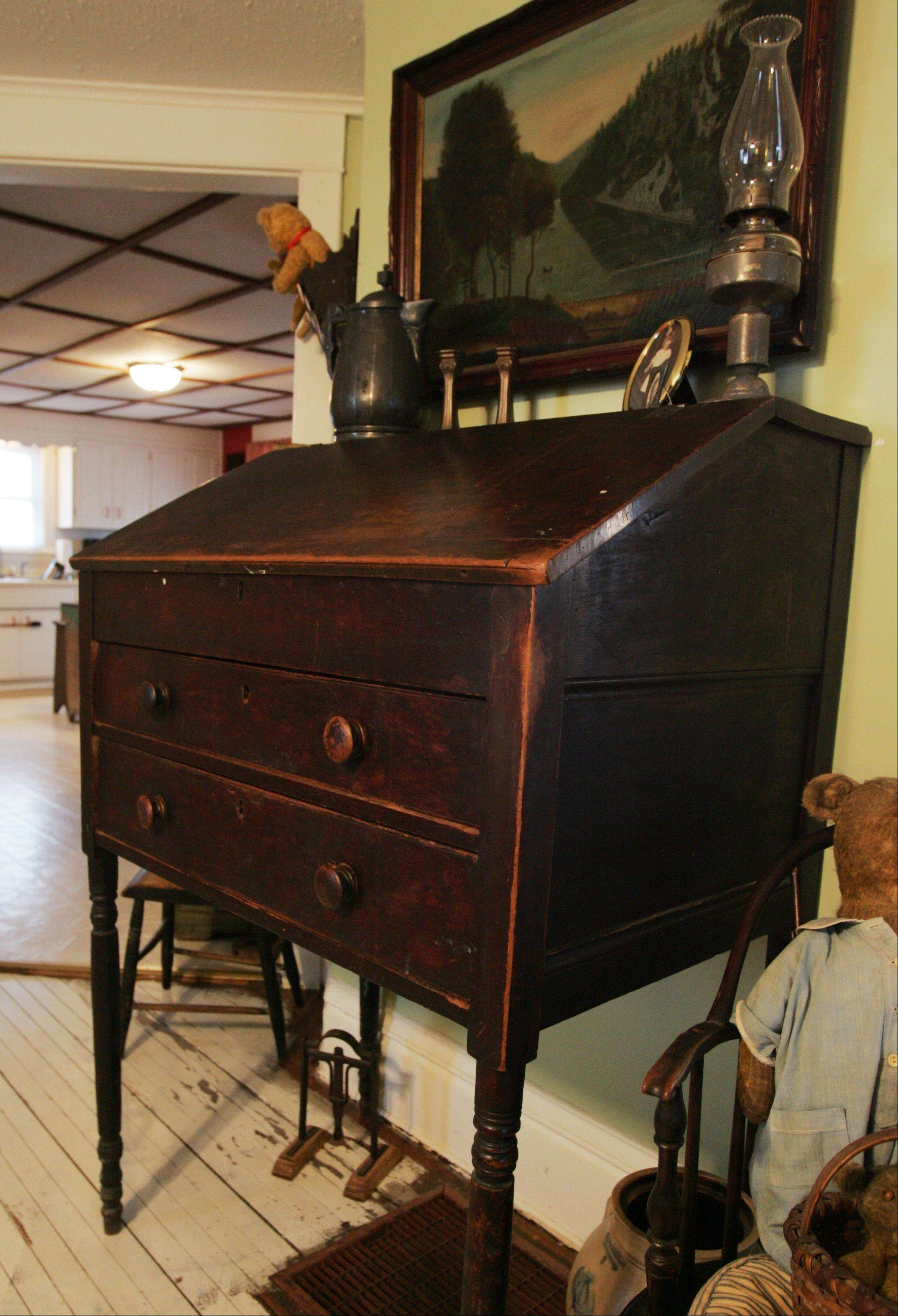 An antique desk at the Springob home has special meaning for Mary; it is a family heirloom estimated to be more than 200 years old.