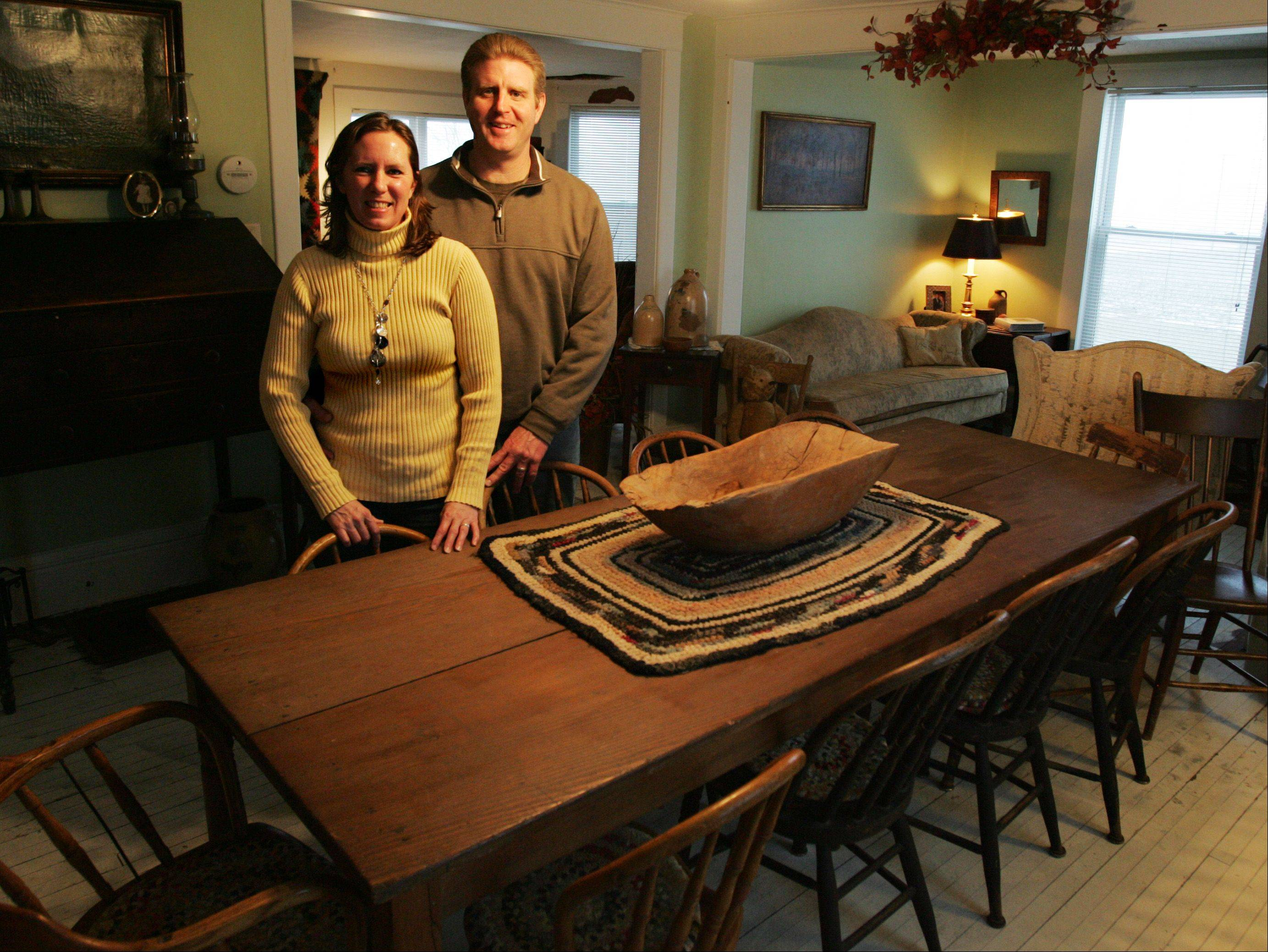 Chuck and Mary Springob of Sycamore in their dining room. Their entire house is furnished in antiques.