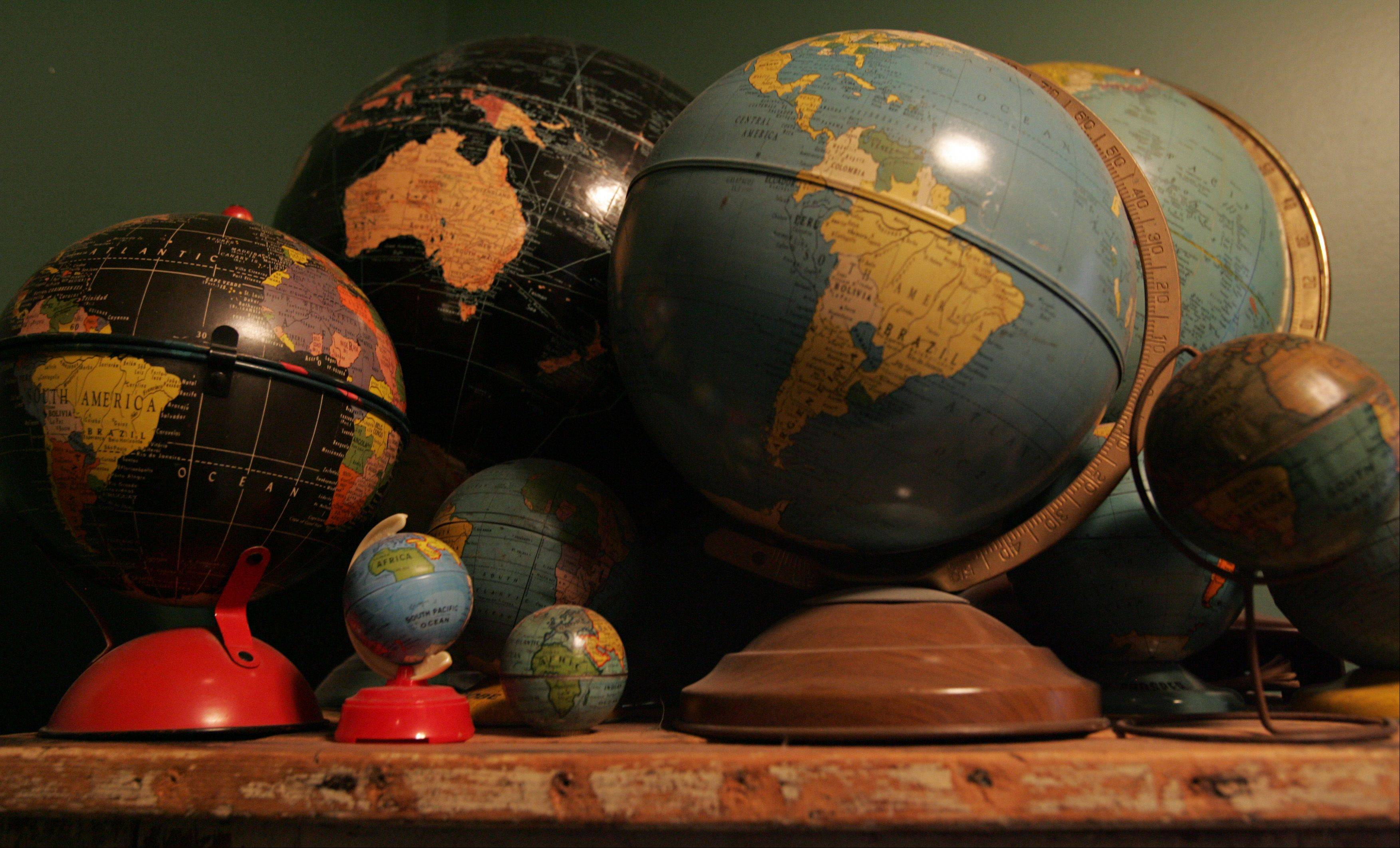 "The couple's collection of globes is extensive. ""I love globes,"" Mary said."