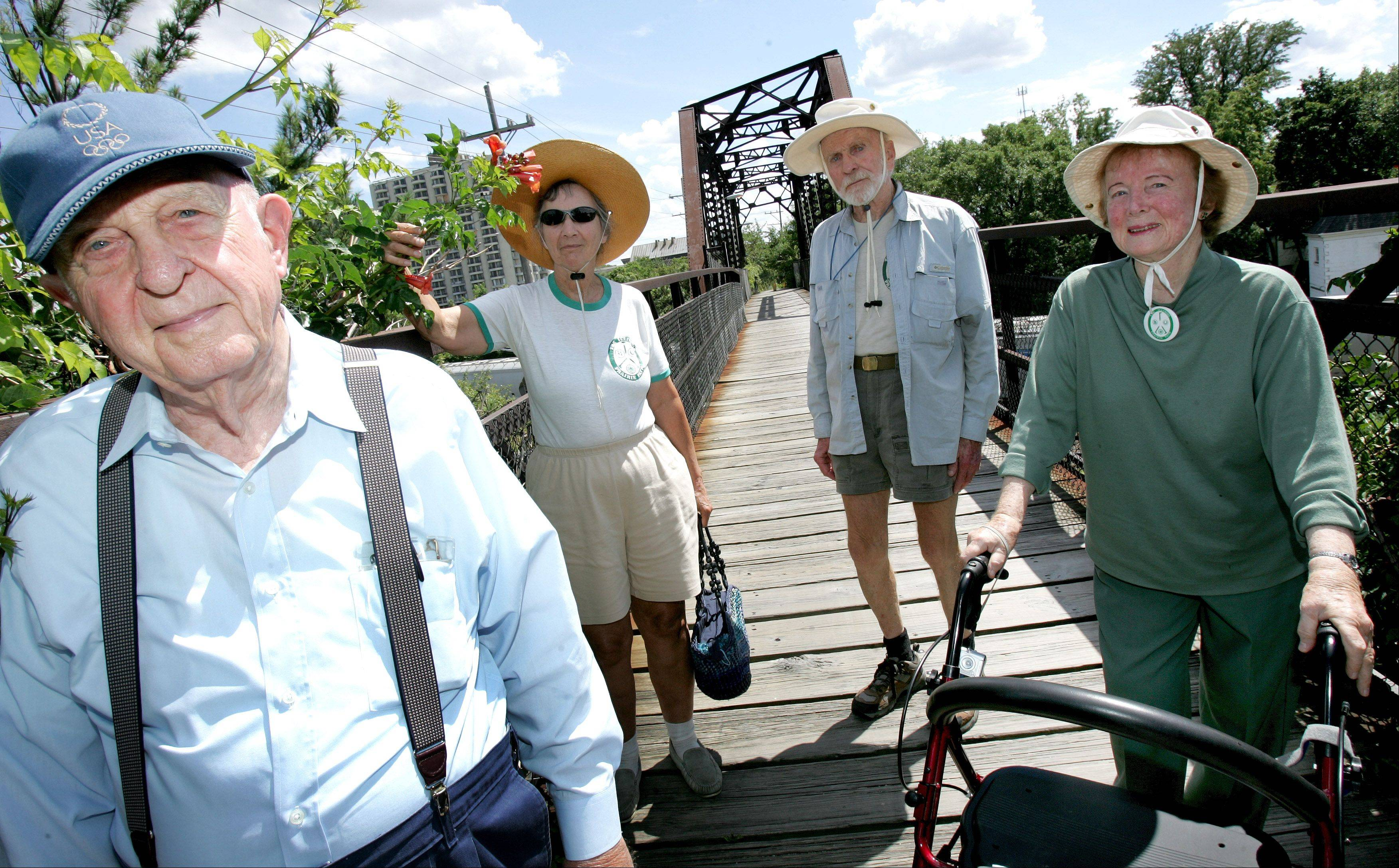 Jean Mooring, right, was a longtime advocate of the Illinois Prairie Path. She is pictured in 2008 with her husband Paul, left, and fellow volunteers Nancy and Dick Wilson at Volunteer Bridge in Wheaton.