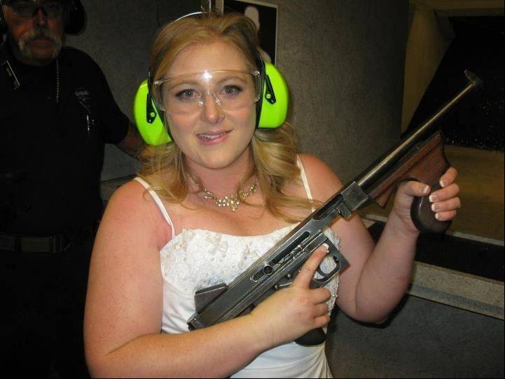 "Lindsae MacDuff holds an automatic weapon at the Gun store in Las Vegas, which has built a permanent ""shotgun weddings"" chapel, because nothing makes a memory quite like the sound of gunfire. Never known for its understatement or good taste, Sin City is bucking the national trend of avoiding flippant gun promotions after the Newtown, Conn., elementary school shooting."