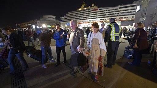 A cruise ship disabled for five nightmarish days in the Gulf of Mexico finally docked with some 4,200 people aboard late Thursday, passengers raucously cheering the end to an ocean odyssey they say was marked by overflowing toilets, food shortages and foul odors. About four hours later, the last of the passengers had gotten off the ship.