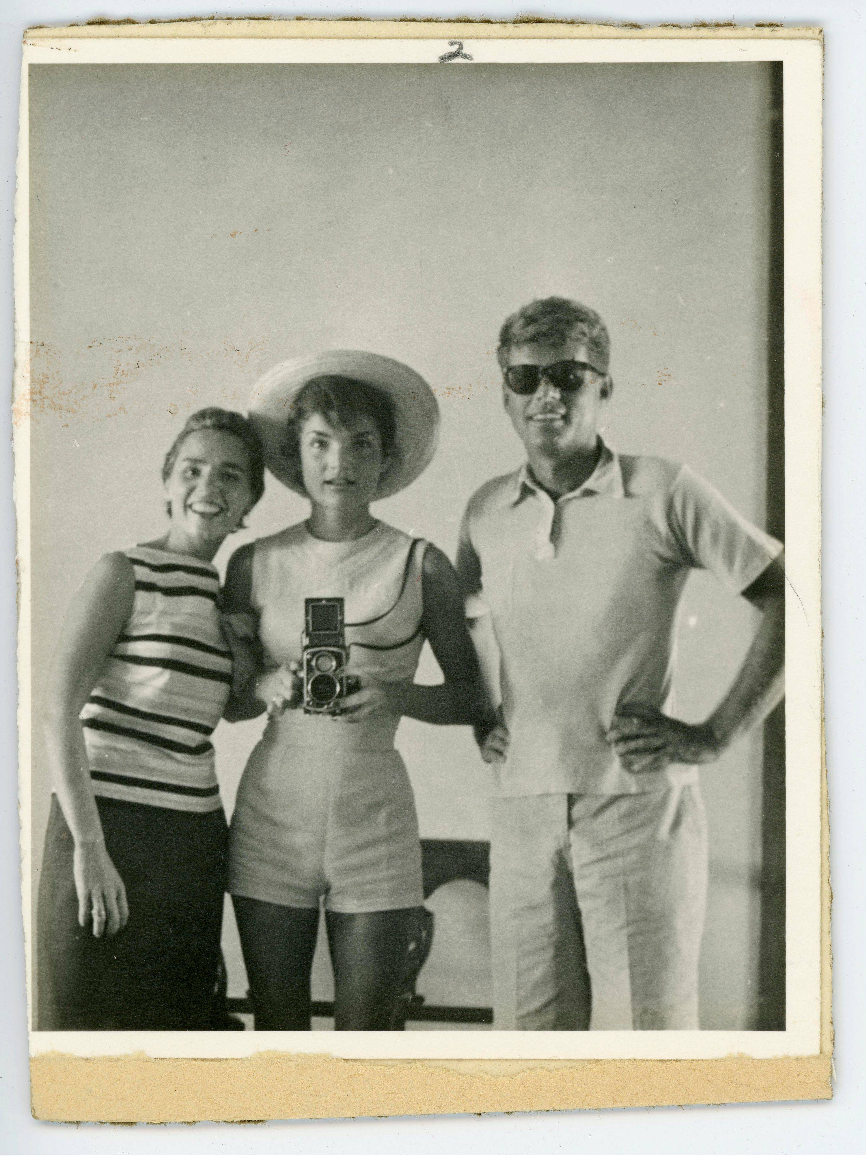 President John F. Kennedy with his wife, Jacqueline, center, and sister-in-law Ethyl Kennedy.