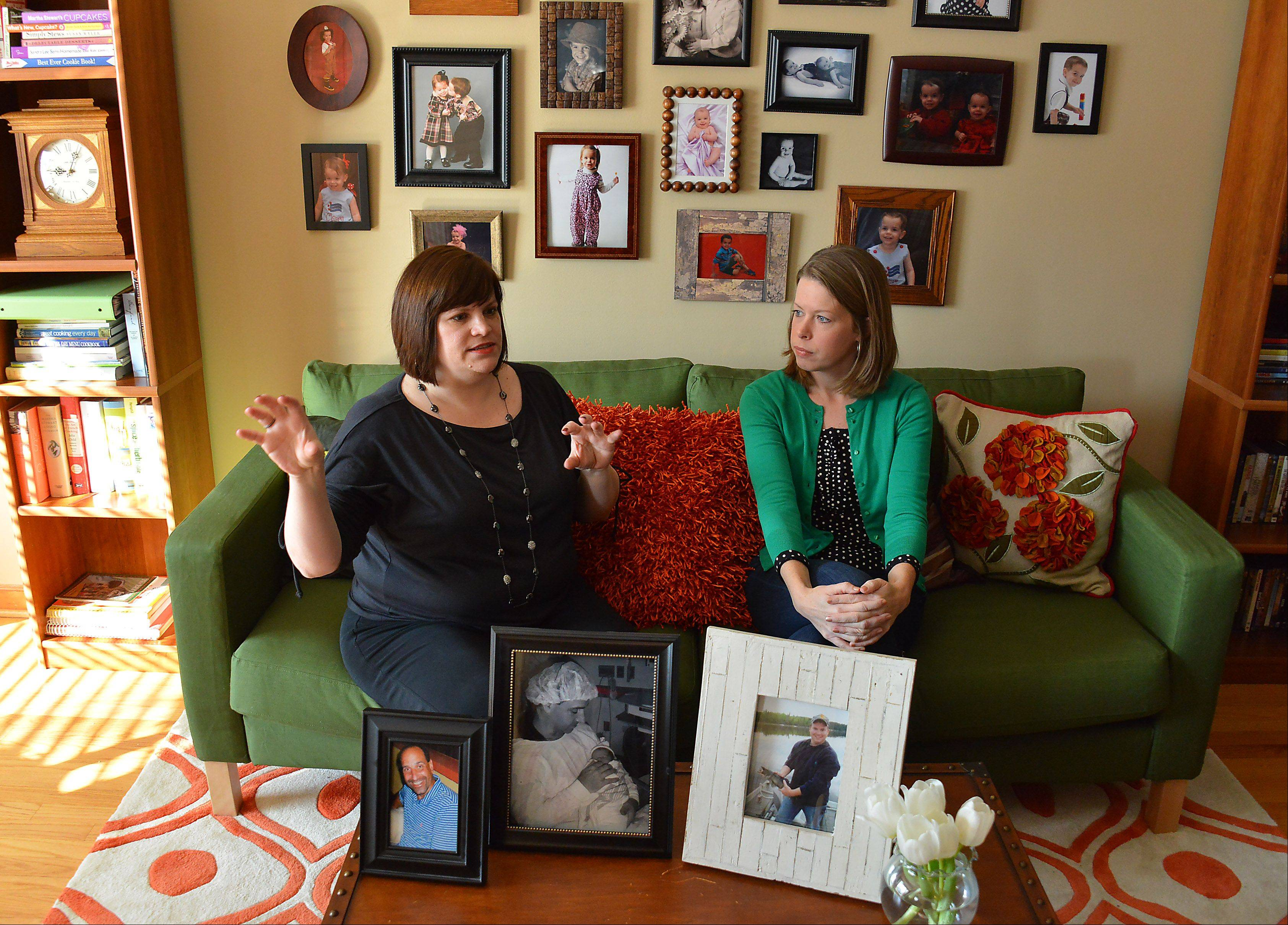 With photographs of their late husbands on the coffee table, Wendy Doyle Diez, left, and Laura Tully Dennis explain how they came together to start the Chicagoland Young Widowed Connection. The group hosts a Valentine & Wine event Saturday in Glenview.