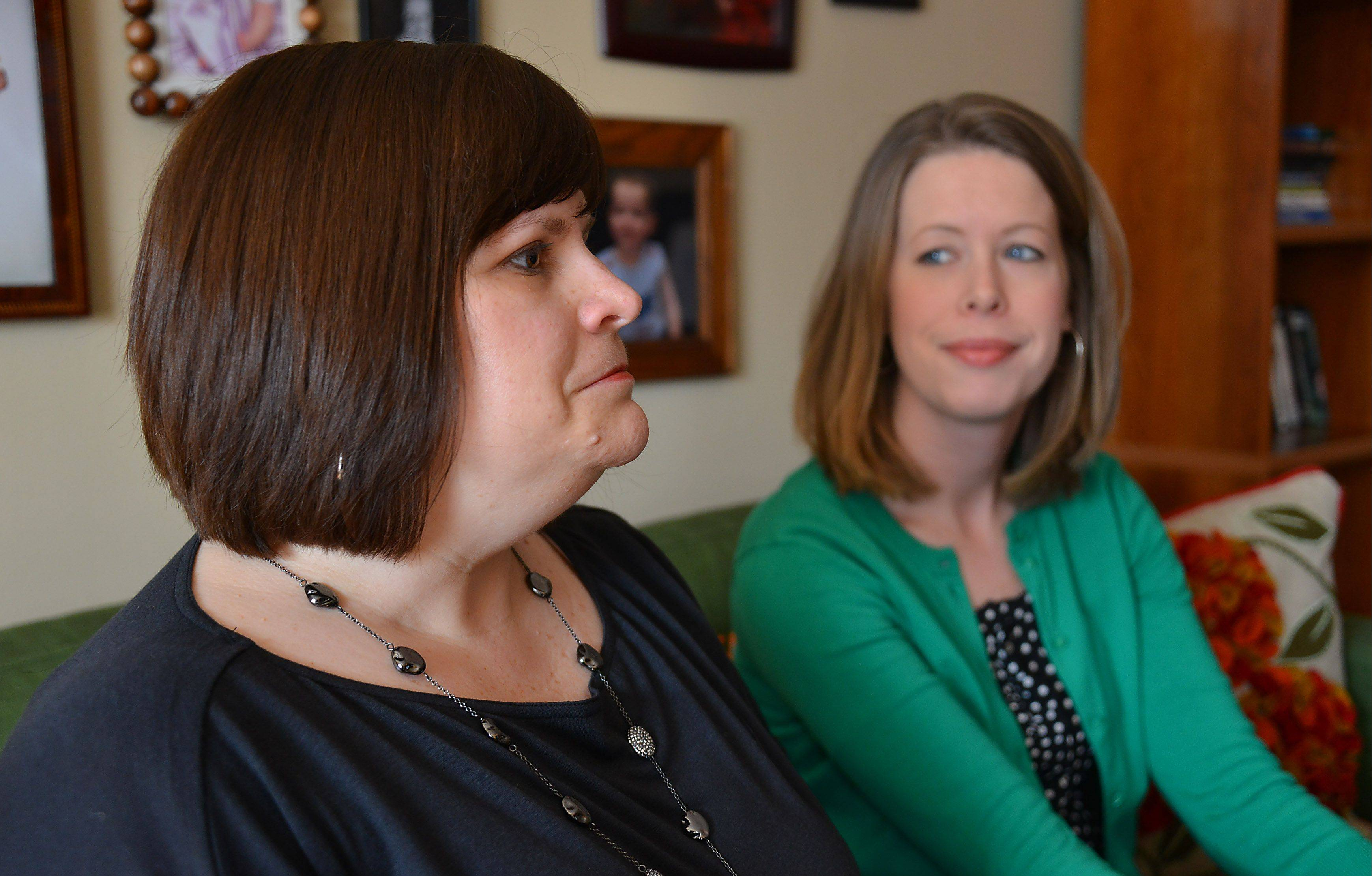 Laura Dennis, right, says she understands when friend Wendy Diez tells the story of how her husband, Chris, died 10 days after the birth of their daughter. Dennis' husband, Kevin, died of a heart attack at age 31.