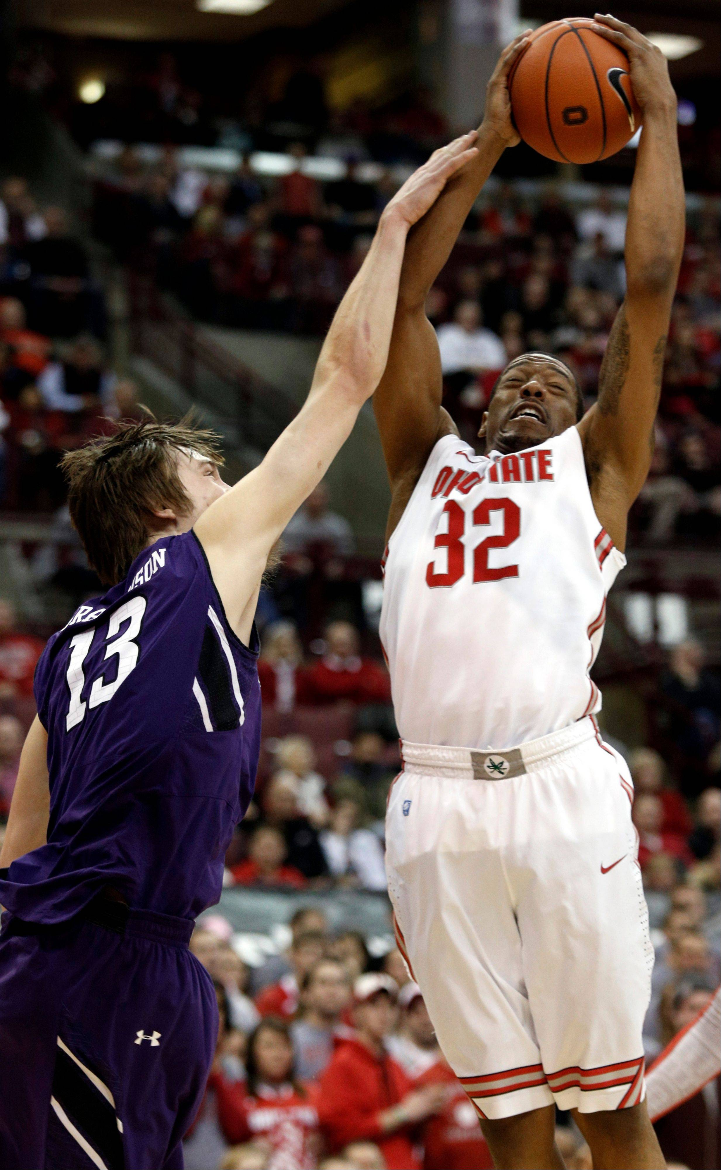 Ohio State's Lenzelle Smith Jr., right, works for a rebound against Northwestern's Kale Abrahamson during the first half of an NCAA college basketball game in Columbus, Ohio, Thursday, Feb. 14, 2013.