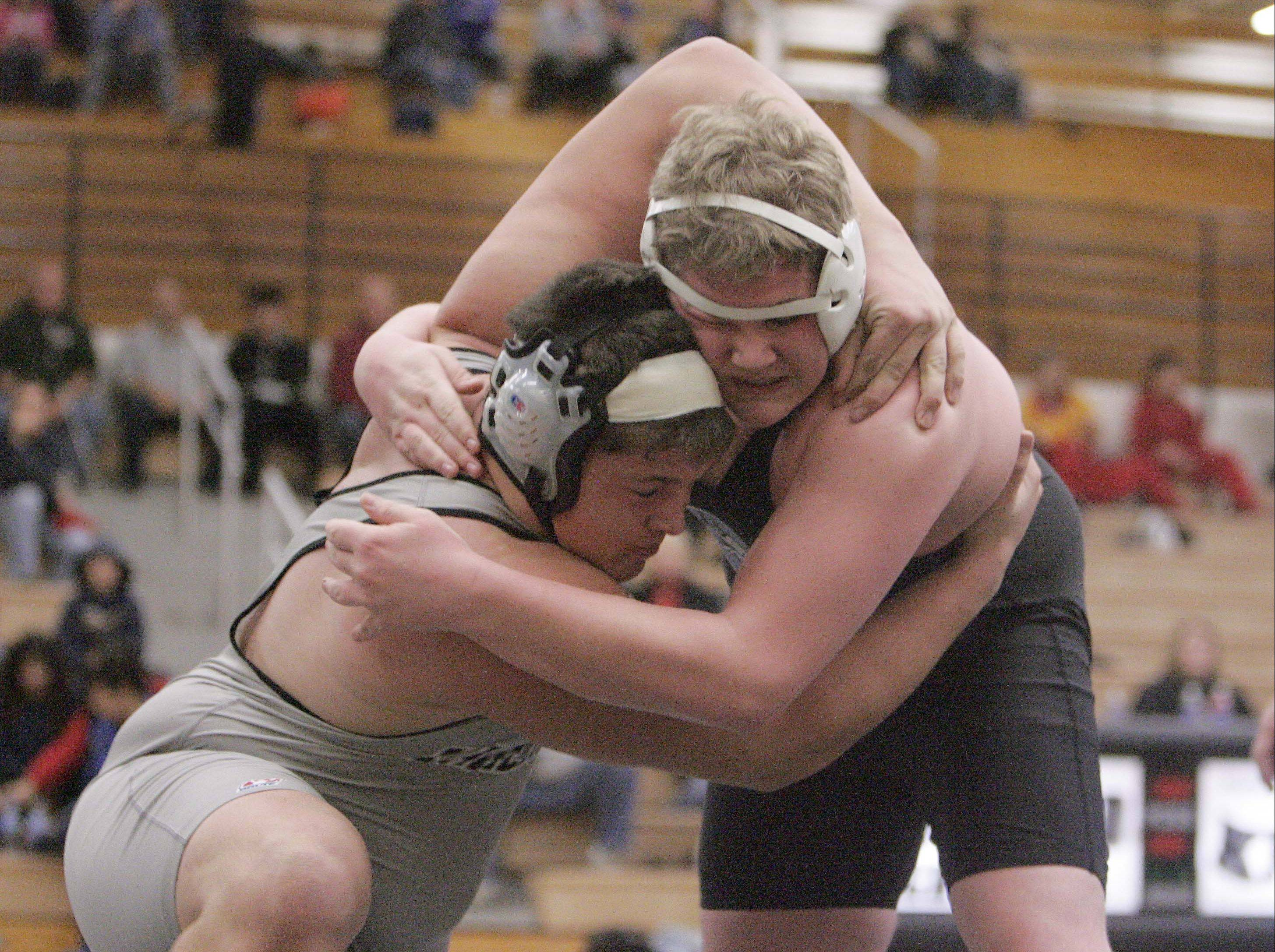 Kaneland's Zach Theis, pictured wrestling Geneva's Jake Anderson, is headed to state with two teammates after just missing last year.