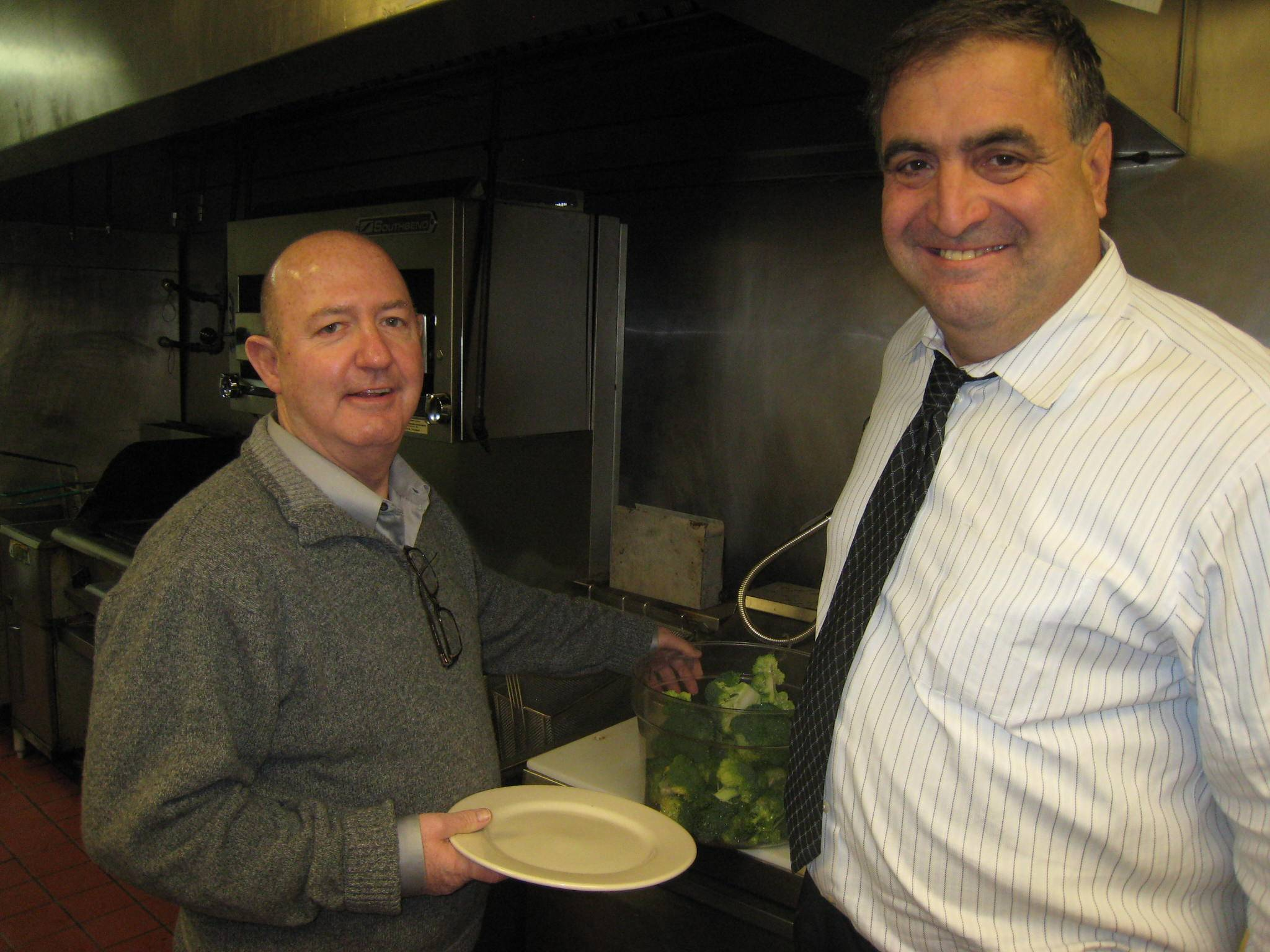 Kiwanis Pasta Chefs Bob Ciserella (left) and Carl Scolaro discuss the finer points of cooking in preparation for the Kiwanis Pasta Dinner.