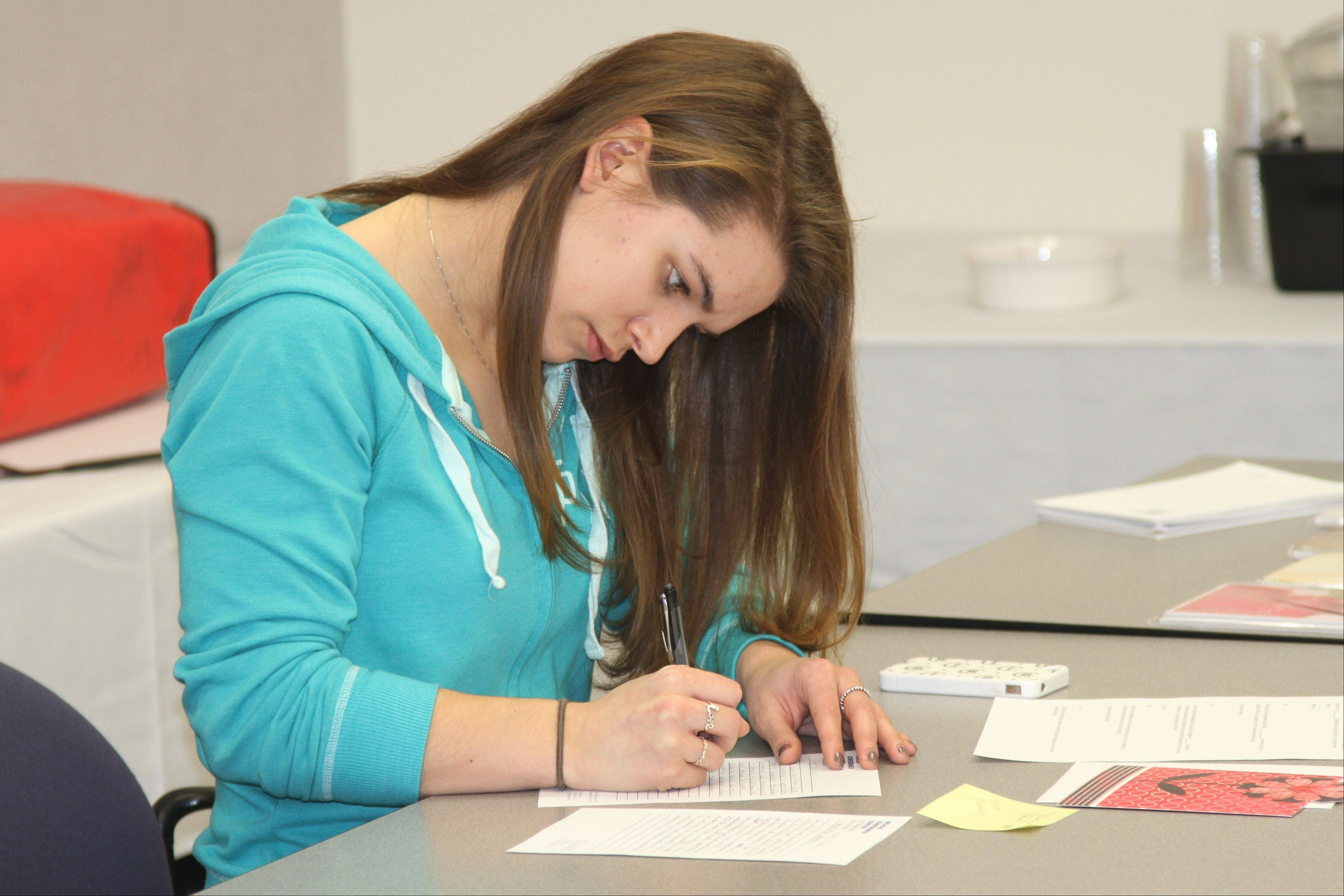 A Harper College scholarship recipient pens a note of thanks to her donor in honor of Valentine's Day. The effort was organized by the College's Educational Foundation.
