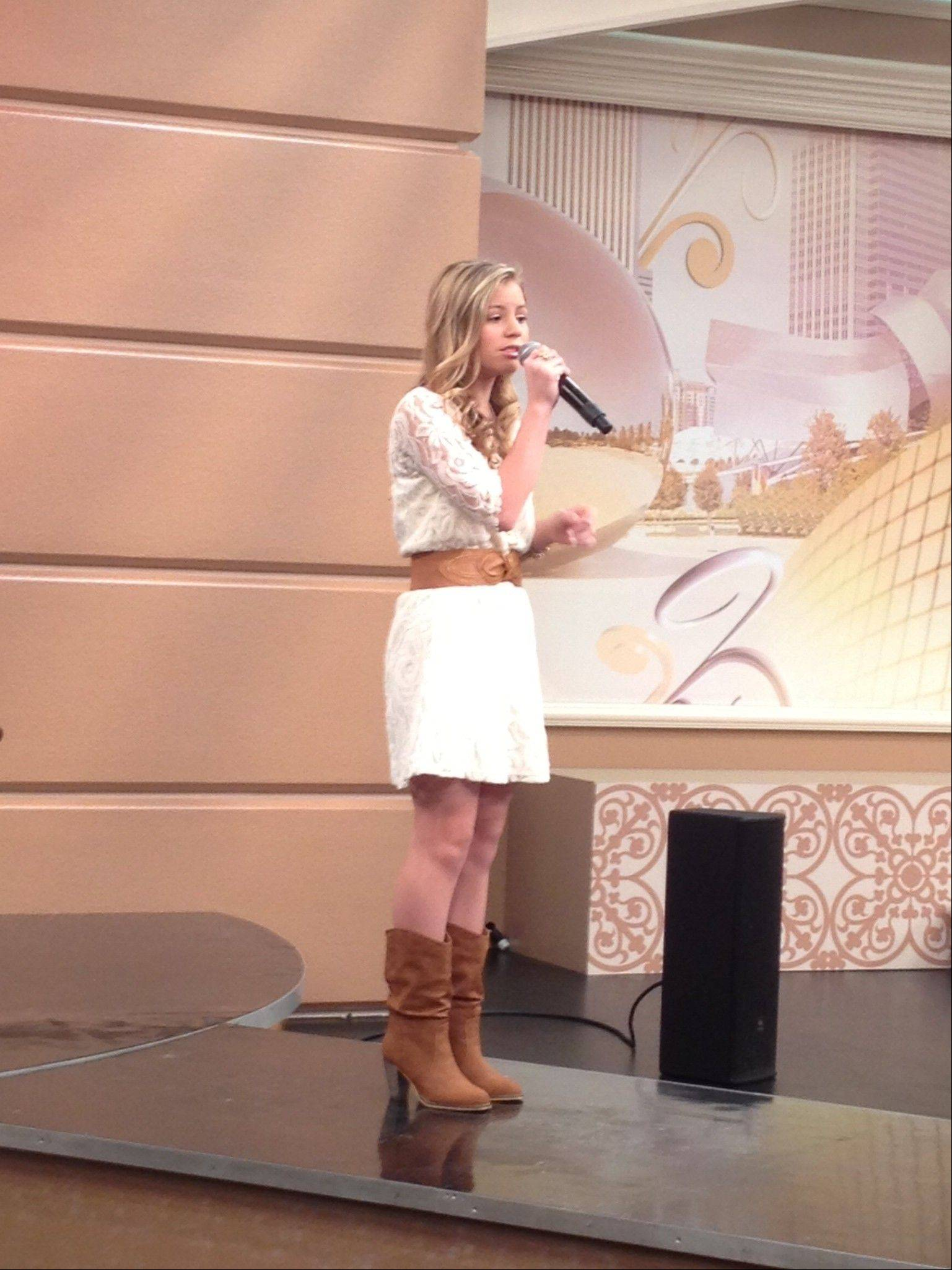 Taylor Matos, 14, sings on Windy City Live as part of the TV show�s Search For A Star Competition. The Elk Grove High School student will learn Friday morning whether she�s one of three finalists in the competition.