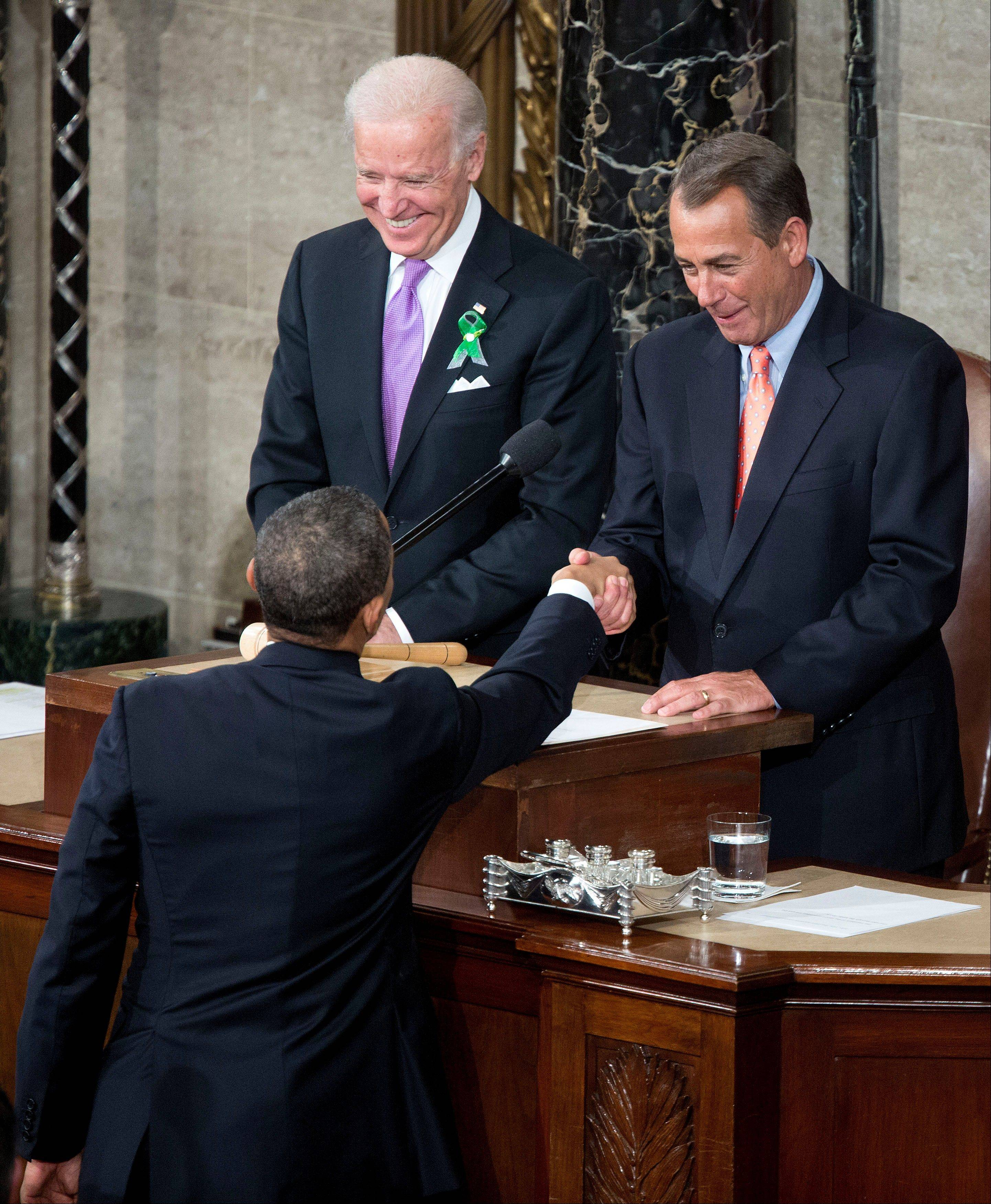 U.S. President Barack Obama greets House Speaker John Boehner, a Republican from Ohio, right, and Joseph �Joe� Biden, U.S. vice president, before delivering the State of the Union address Tuesday.