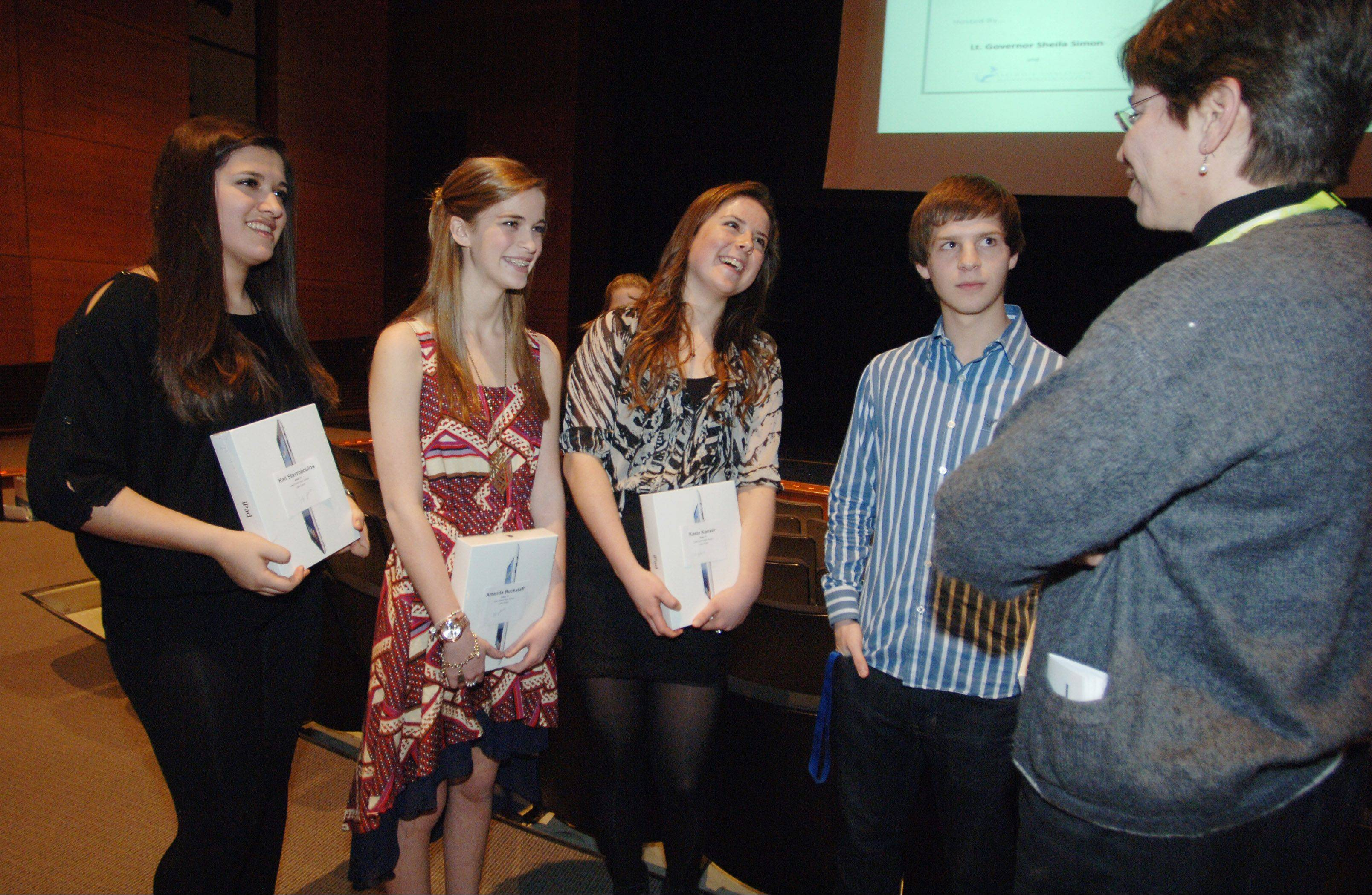 Lt. Governor Sheila Simon, right, chats with Lake Zurich High School students Kati Stavropoulos, left, Amanda Buckstaff, Kasia Konsor and Ian Hesch after they were honored Friday for winning the No More Dating Abuse Video Contest.
