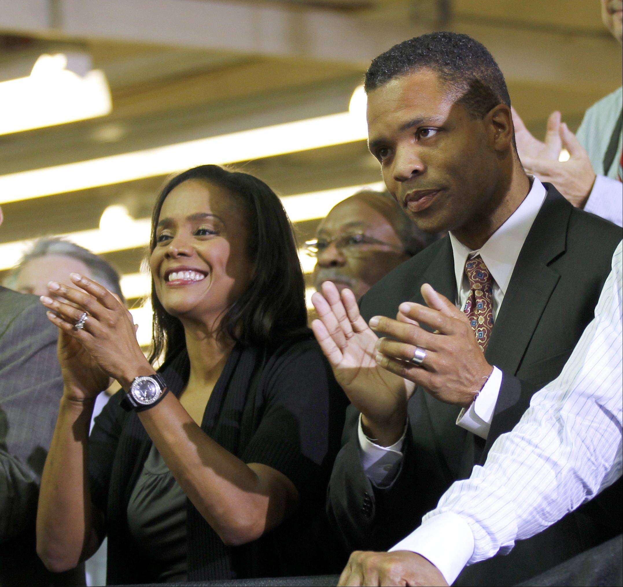 Then-Rep. Jesse Jackson Jr. and his wife, then-Chicago Alderman Sandi Jackson, applaud as President Barack Obama is introduced at Ford Motor Co. plant in Chicago in 2010.