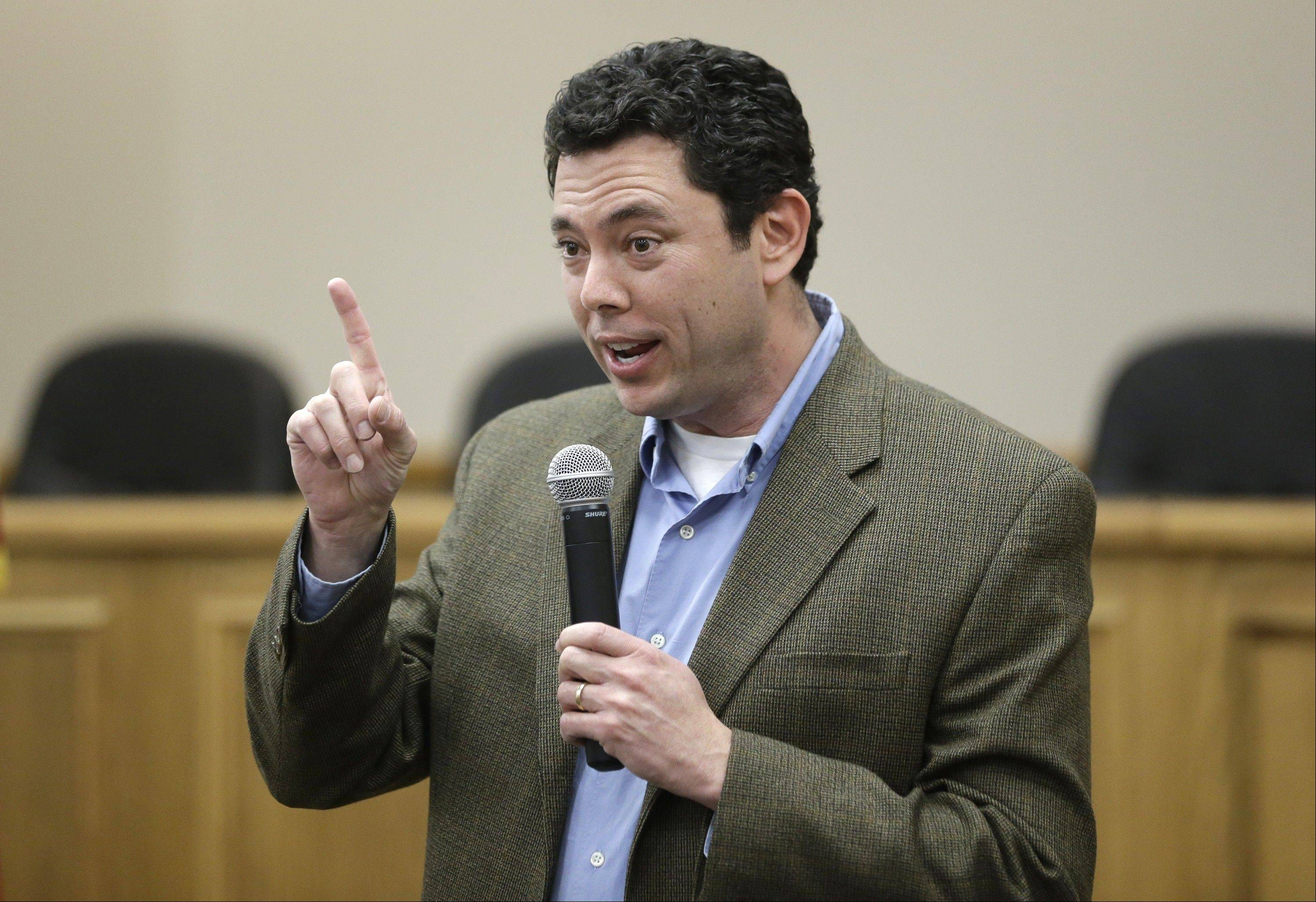 Rep. Jason Chaffetz, R-Utah, makes remarks during a town-hall meeting in Heber City, Utah. Chaffetz flew home from Washington last week to attend the town hall meeting. Many voters here and in similar communities elsewhere still want to do whatever it takes to stop President Obama, and the politicians they elect are listening.