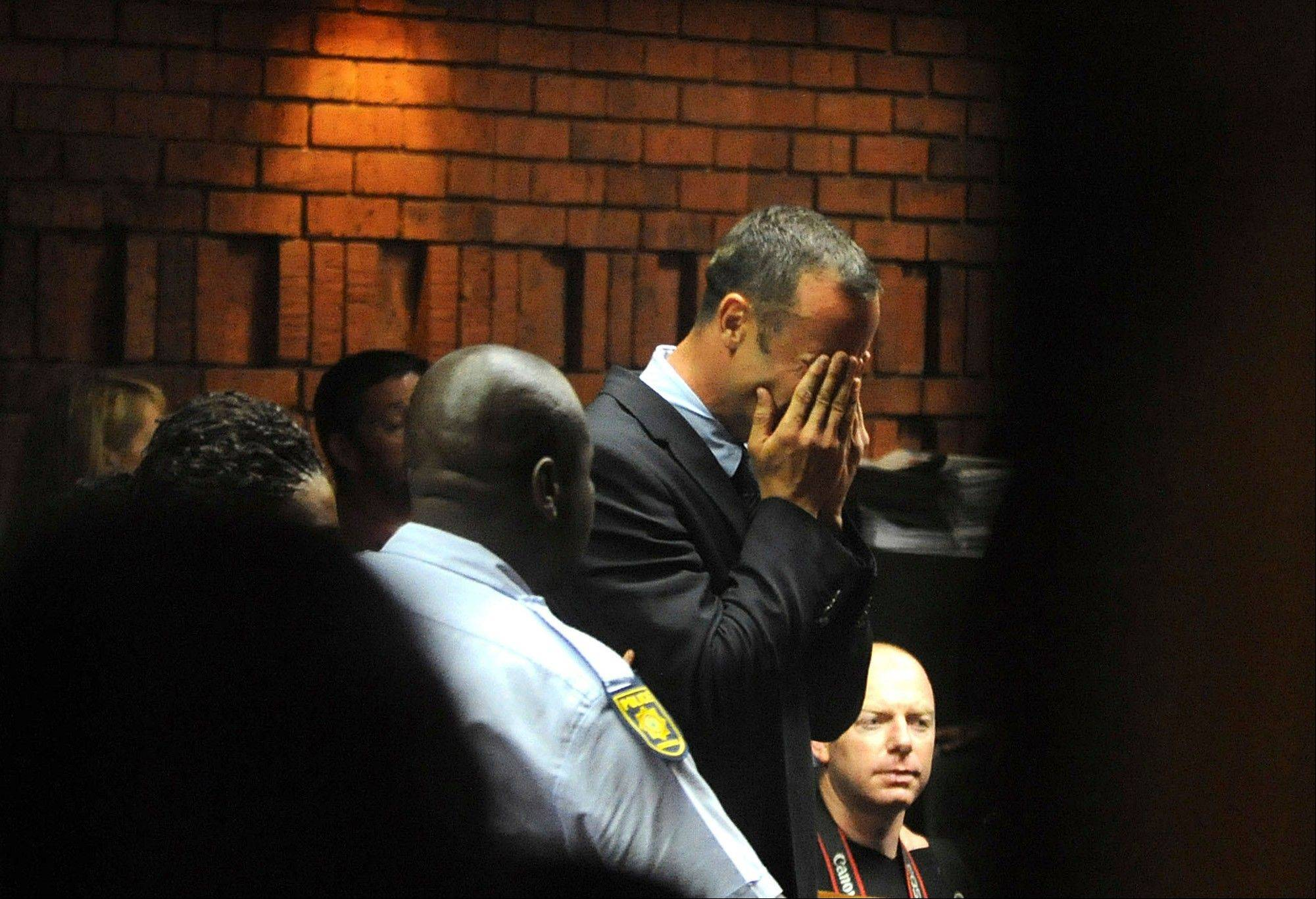 Athlete Oscar Pistorius weeps in court in Pretoria, South Africa, Friday, Feb 15, 2013, at his bail hearing in the murder case of his girlfriend Reeva Steenkamp. Oscar Pistorius arrived at a courthouse Friday, for his bail hearing in the murder case of his girlfriend as South Africans braced themselves for the latest development in a story that has stunned the country.