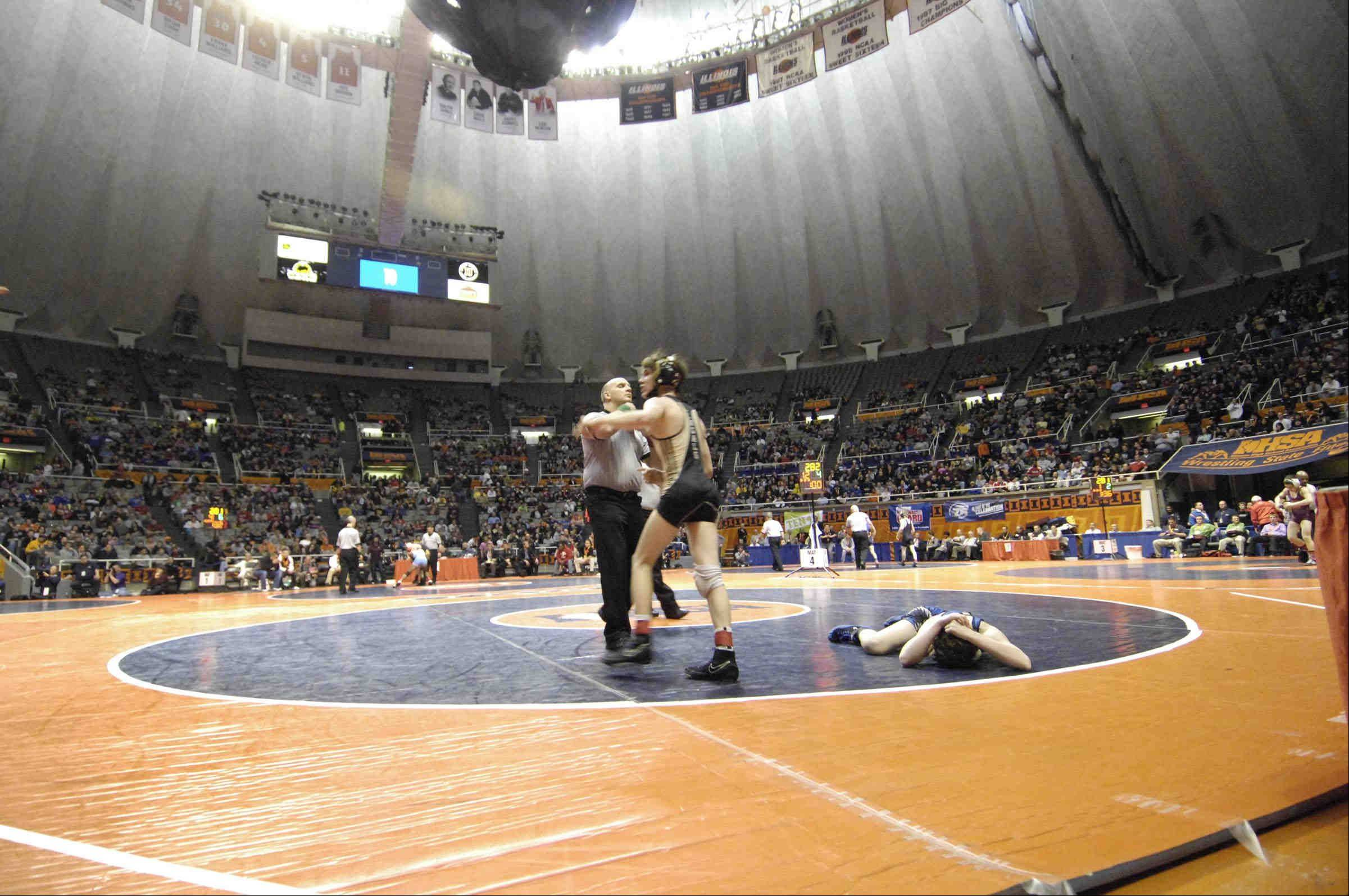 Vernon Hills� Jordan Reich covers his head on the mat in defeat to Danny Swan of Oak Forest in the 106-pound Class 2A IHSA semifinal wrestling match at Assembly Hall in Champaign Friday.
