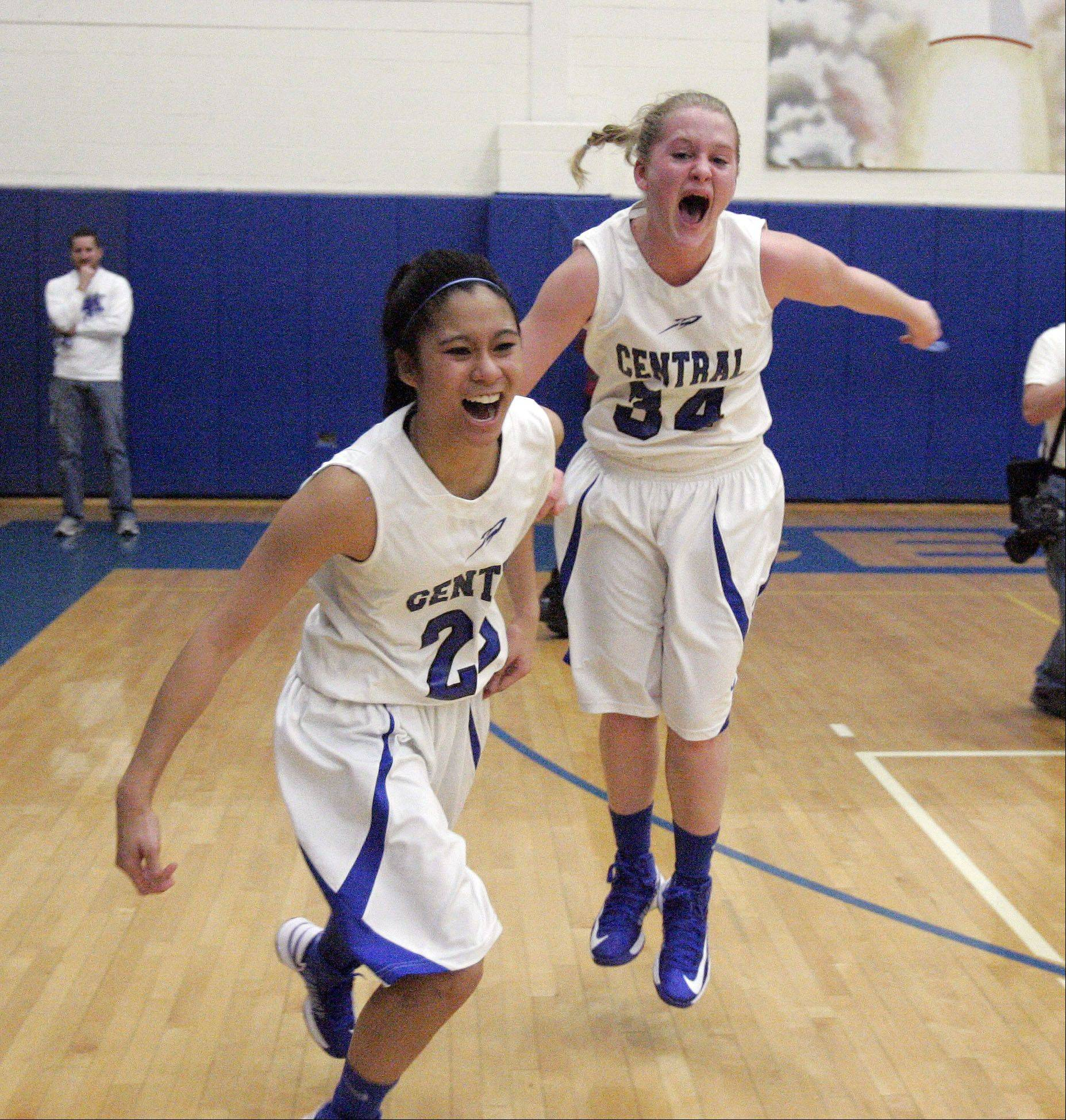 Burlington Central�s Camille Delacruz (23) and Samantha Pryor (34) Celebrate after Burlington Central beat Plano 38-34 for the IHSA Class 3A regional girls basketball championship Friday February 15, 2013 at Burlington.