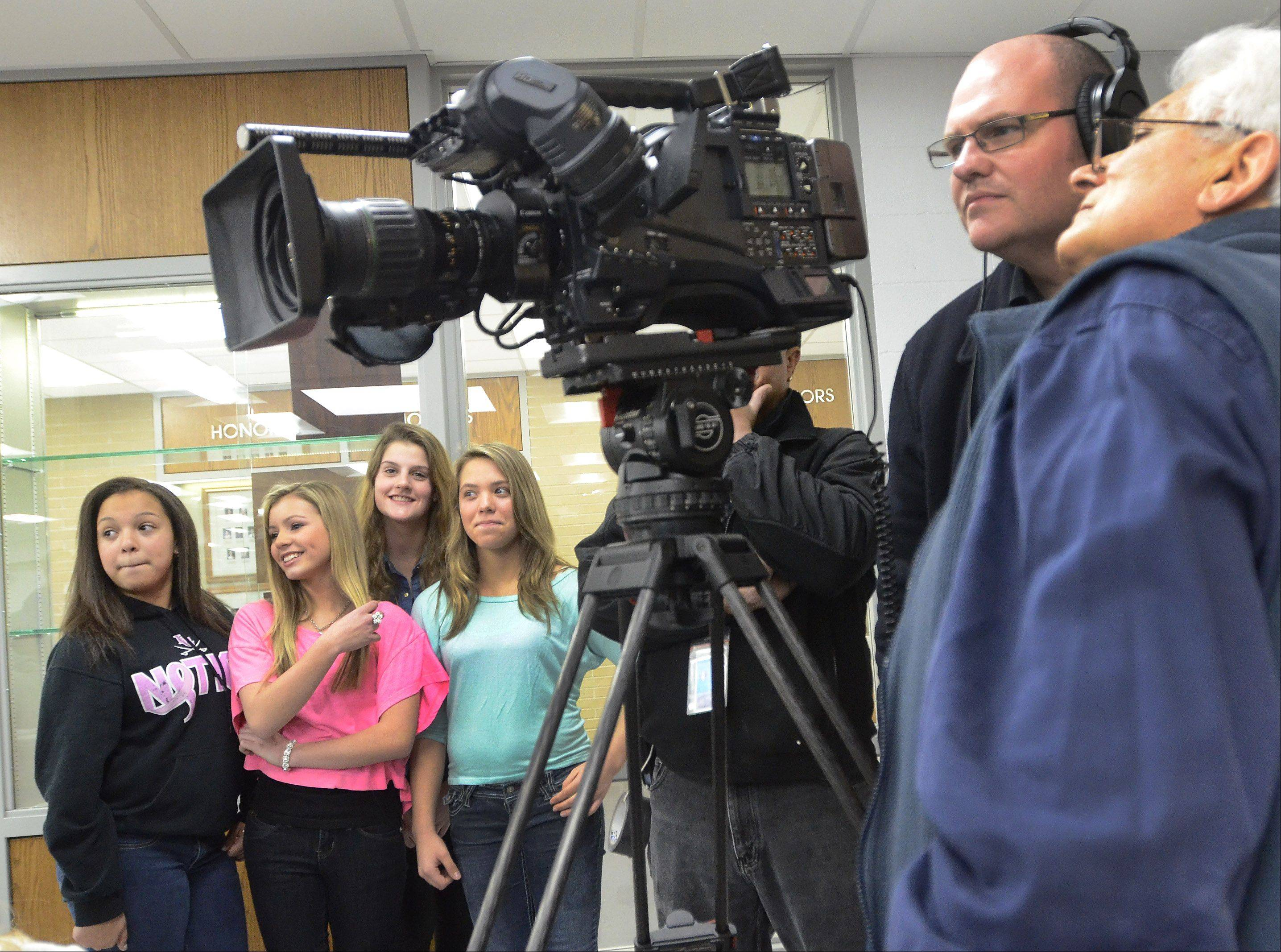 Taylor Matos waits with friends Gabby Vasquez, left, Maddie Pignato and Anna Bonder to do a television spot for ABC 7.