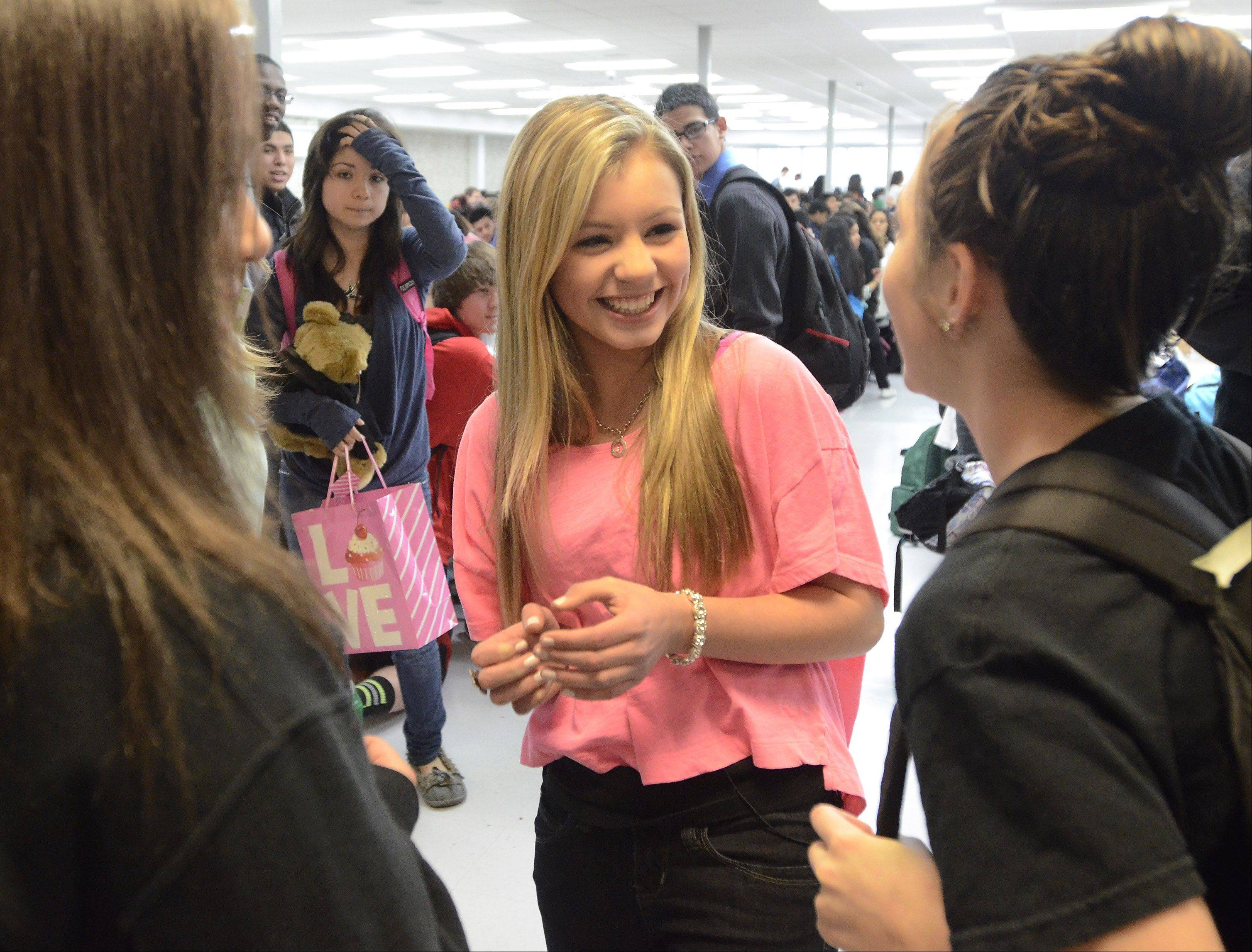 14-year-old Taylor Matos talks with friends Gabby Vasquez, left, and Mia Picchi.
