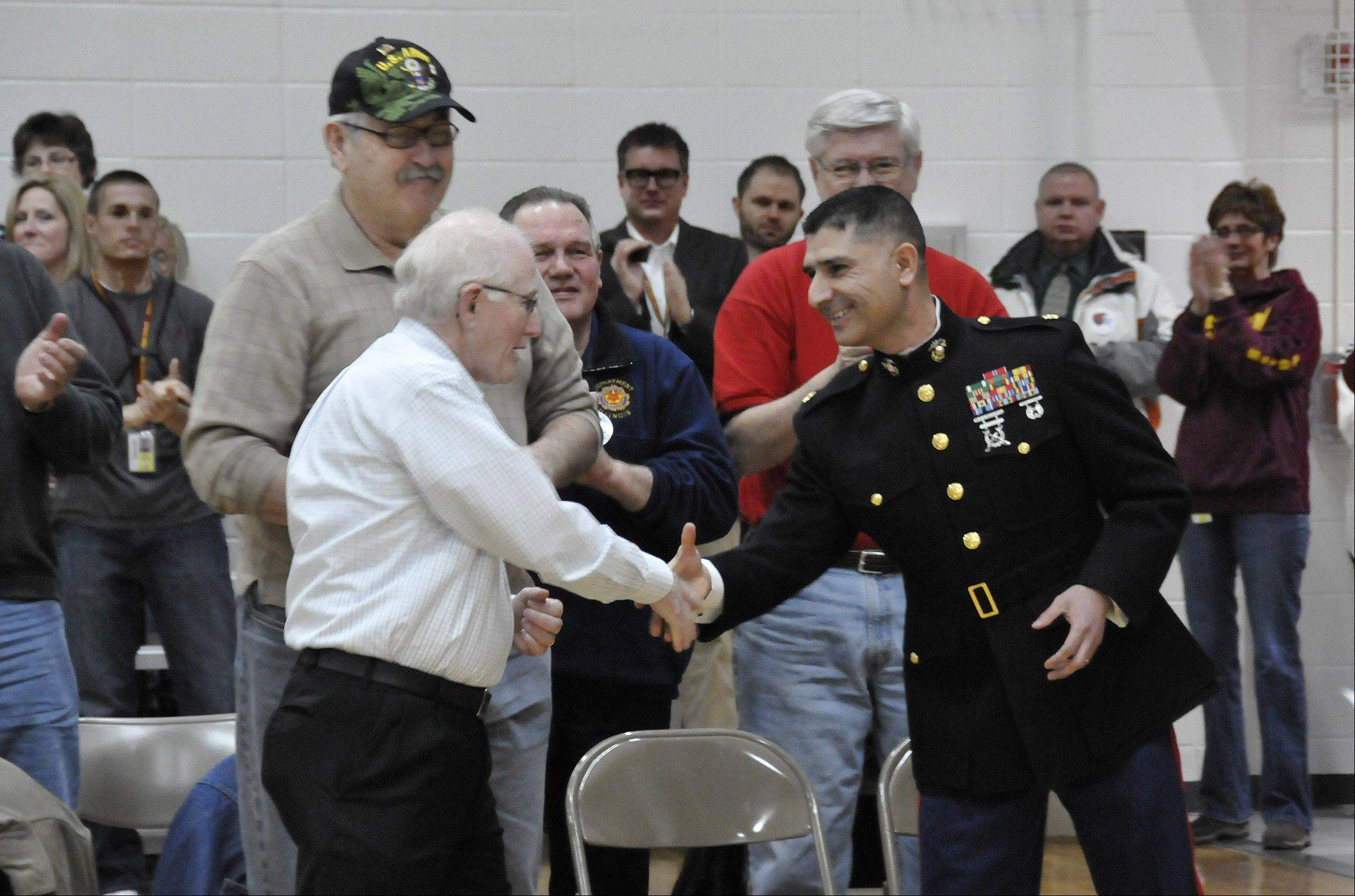 Marine Maj. Guillermo Rosales greeted a small group of veterans in attendance Friday for his presentation at Kennedy Junior High School.