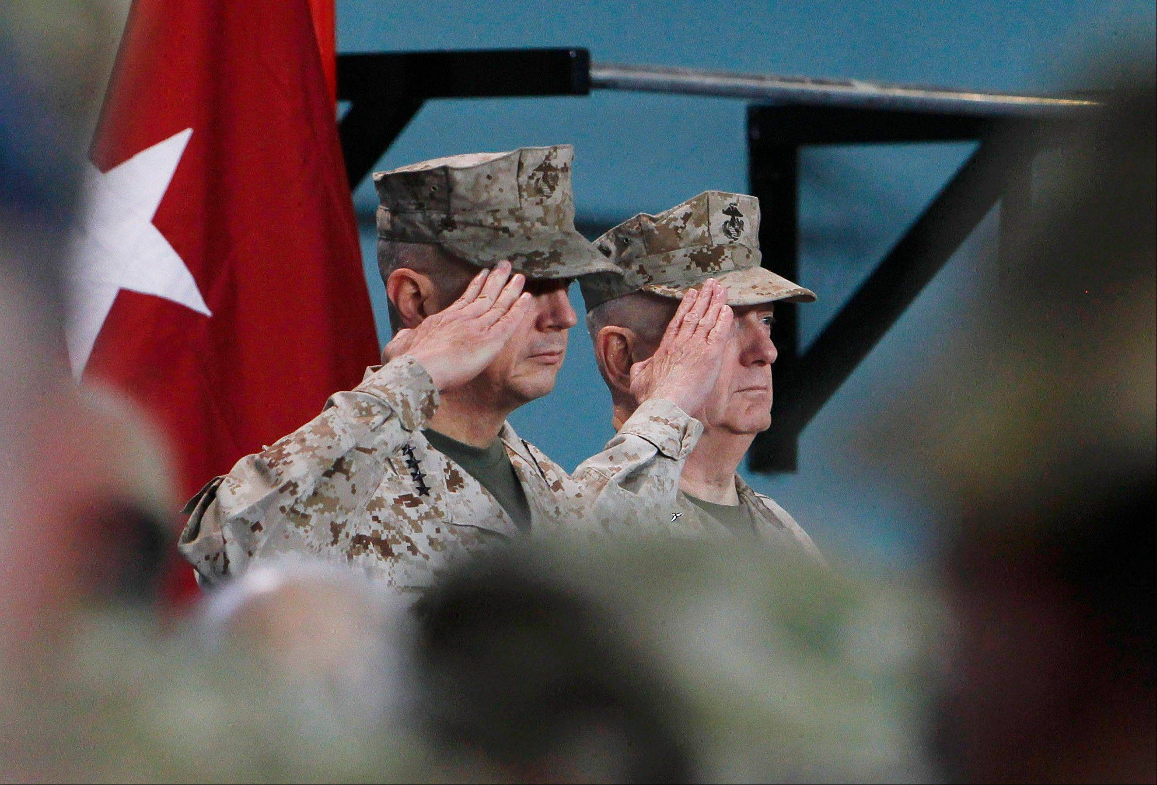 U.S. Gen. John Allen, left, the outgoing U.S. and NATO- led International Security Assistance Force (ISAF) commander in Afghanistan salutes with upcoming U.S. and NATO-led International Security Assistance Force commander in Afghanistan U.S. Gen. Joseph Dunford last Sunday during a changing of command ceremony in Kabul, Afghanistan.