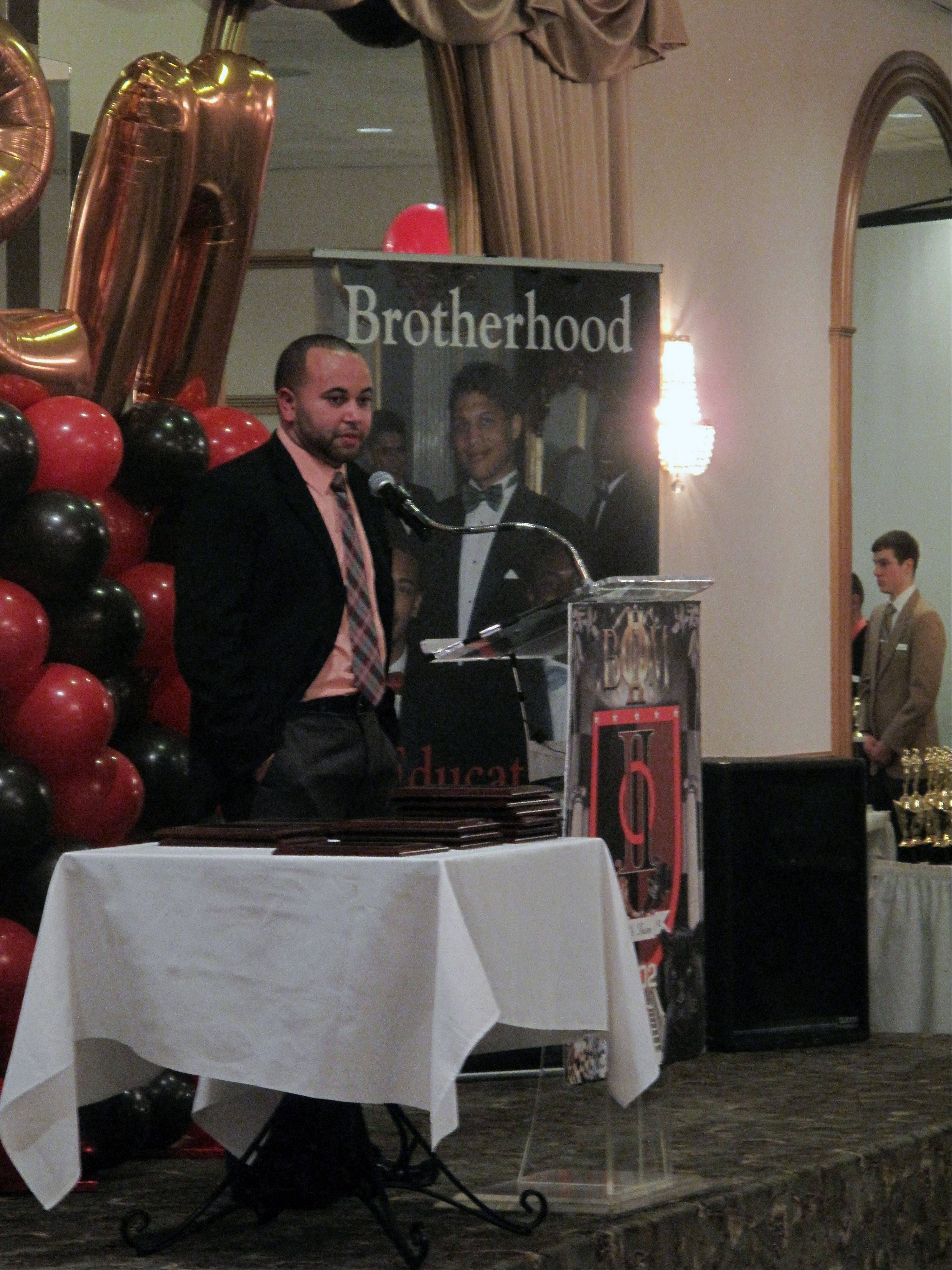 Jared Marchiando, the first president of the Boys II Men brotherhood in Aurora, is honored as one of the fraternity's 2013 Phenomenal Men of the Year. The brotherhood has included more than 200 members since Marchiando was among its 12 founding members in 2002.