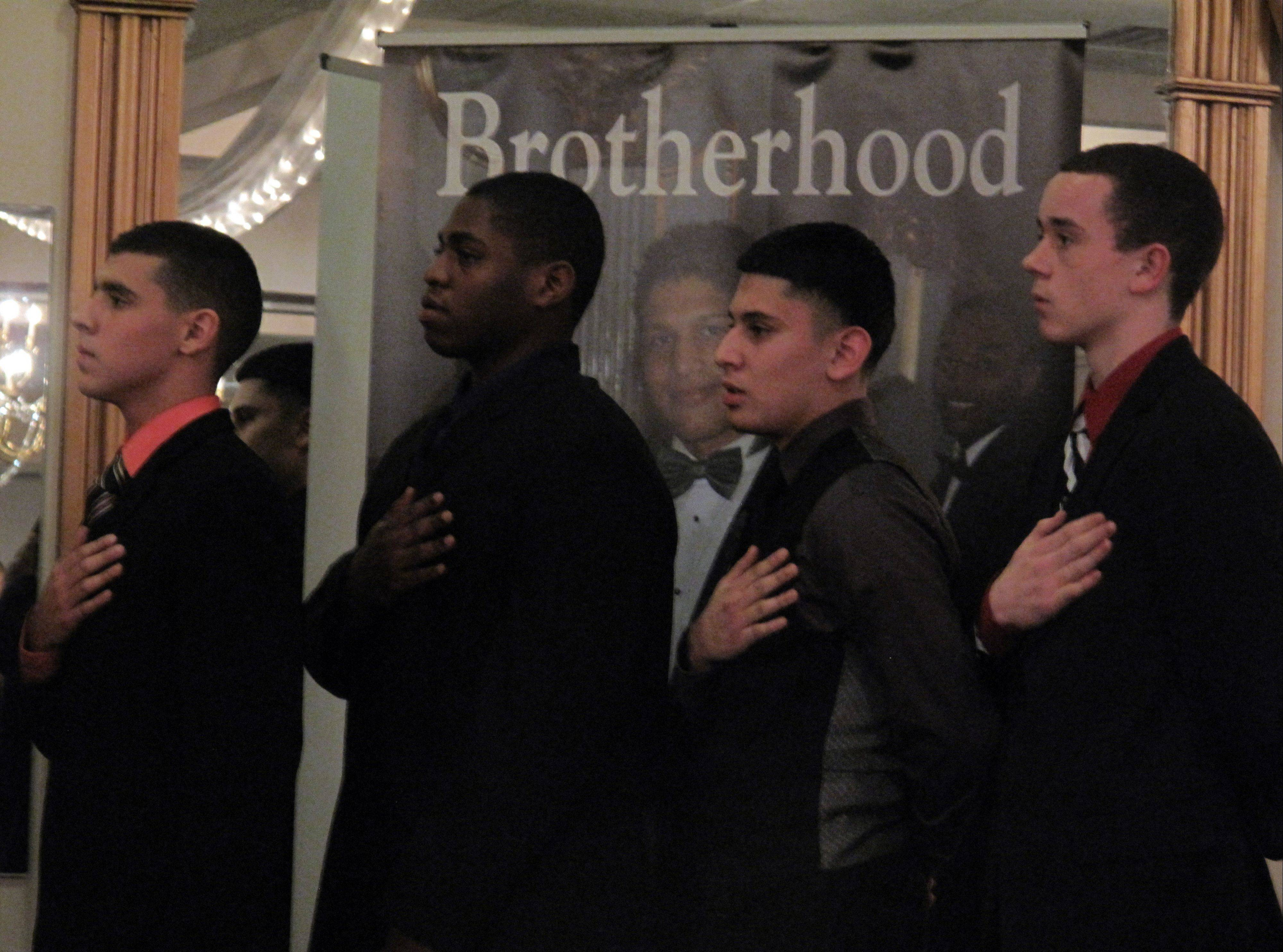 Raul Chaidez, Michael Hughes, Brian Moreno and Erik Strand, all Aurora high school students and leaders in Boys II Men, celebrate their brotherhood during the sixth annual Phenomenal Man Awards.