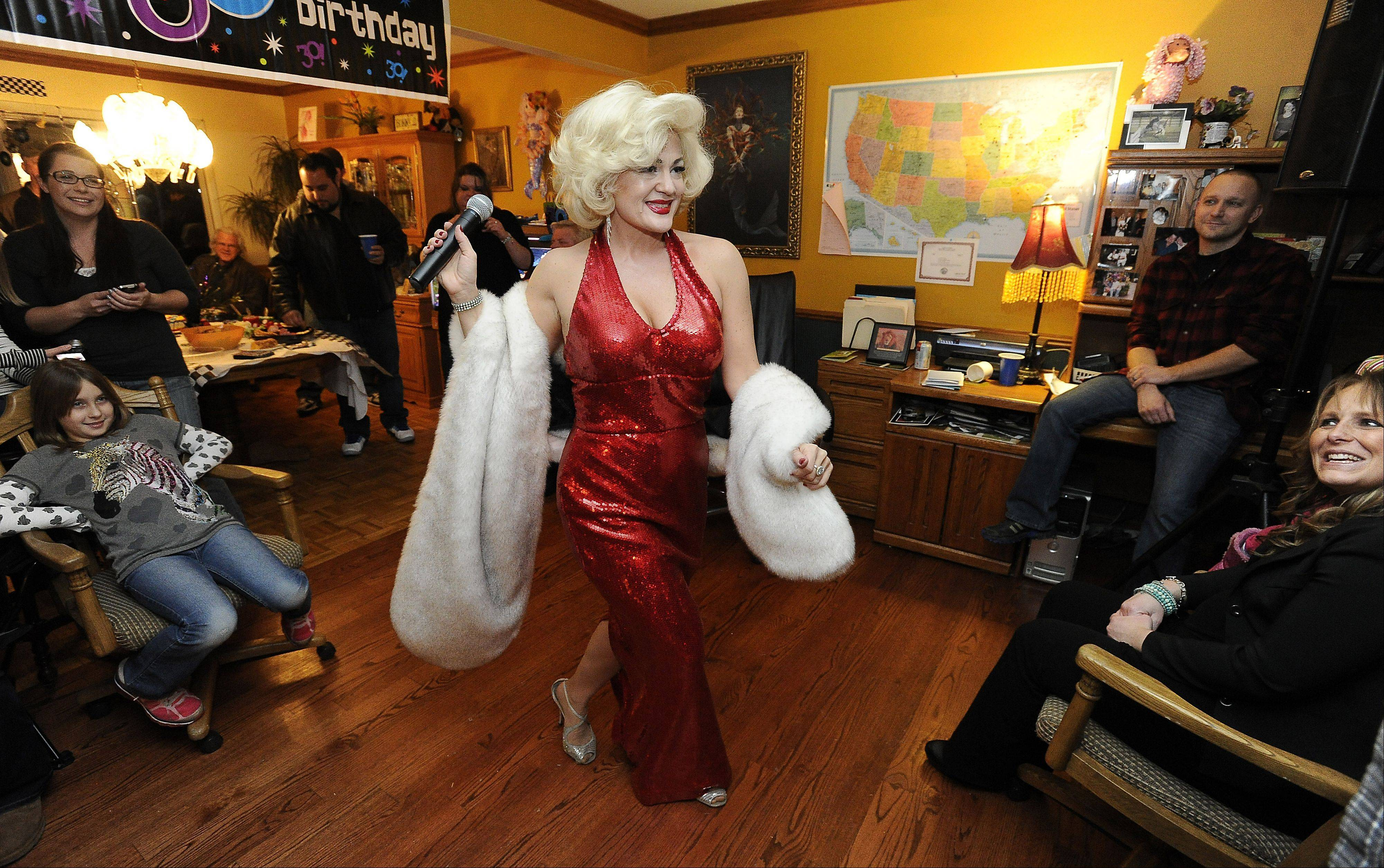 Sheri struts her Marilyn moves at a birthday party for Jaime Merlo in Winfield, getting smiles and giving red lipstick kisses on the faces and heads of the gentlemen as part of the show.