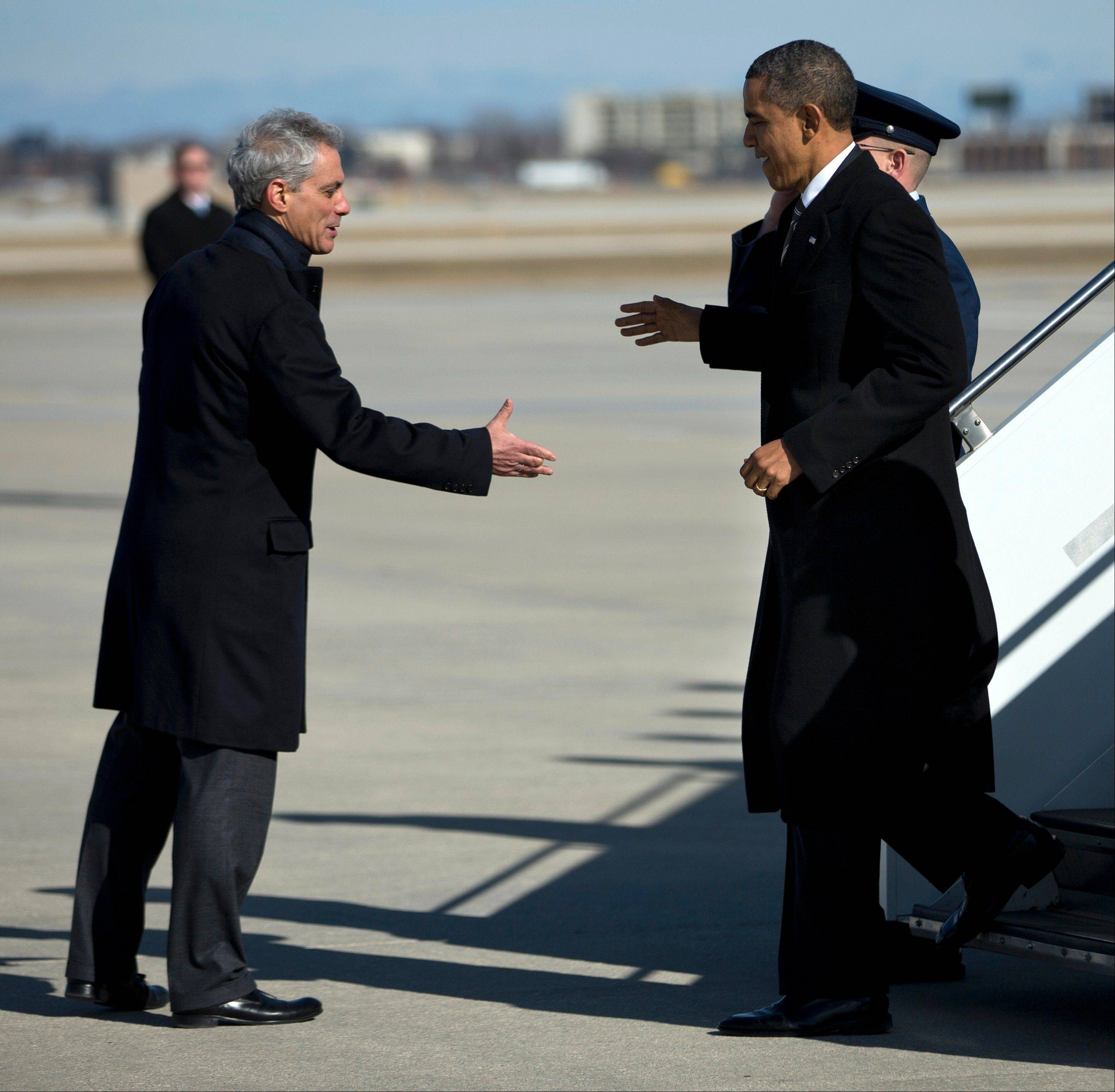 "President Barack Obama is greeted Friday by Chicago Mayor Rahm Emanuel after arriving at O'Hare International Airport. The president Obama went to Chicago to pitch his ""Ladders of opportunity"" economic plan that he laid out in his State of the Union address."