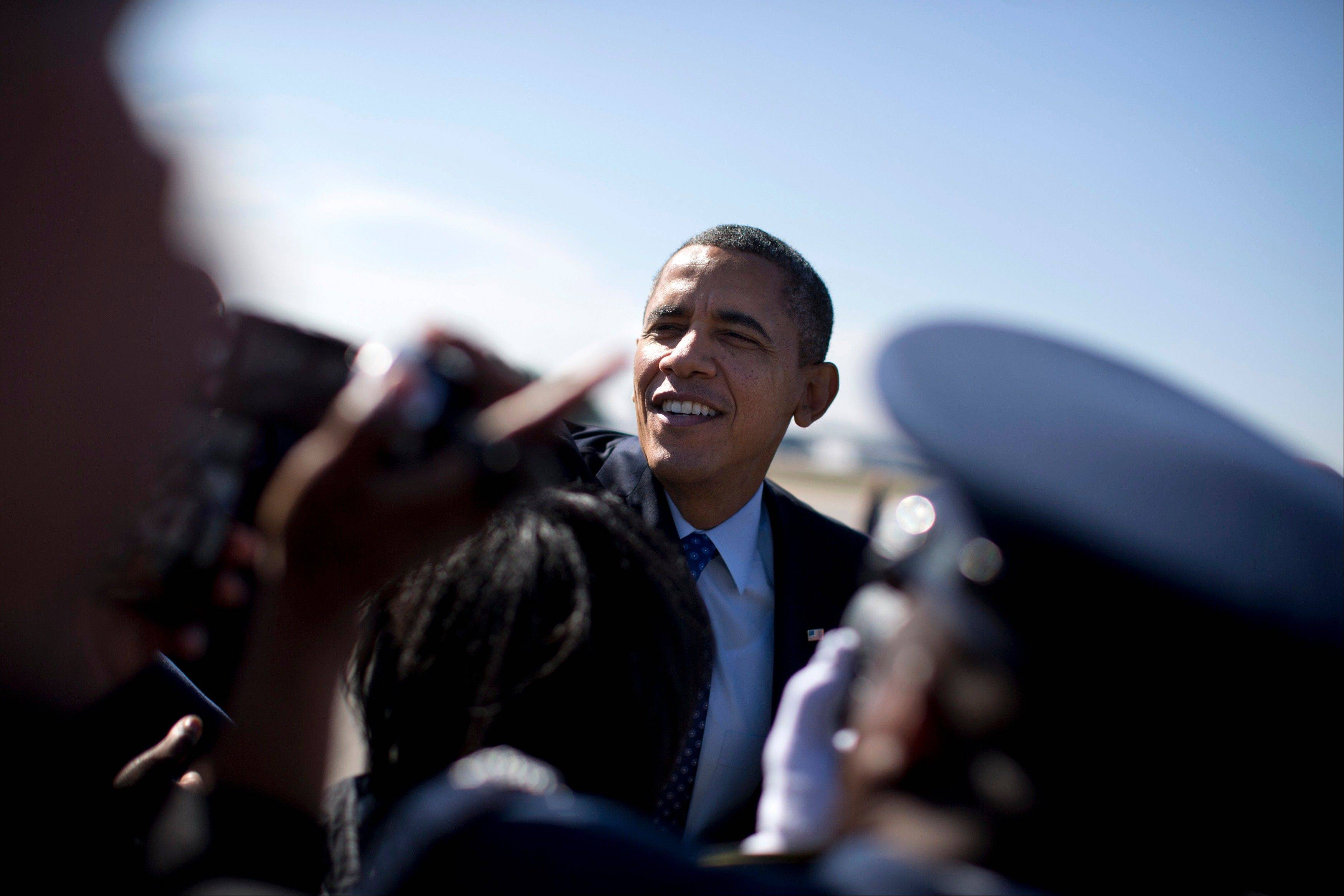 President Barack Obama shakes hands after arriving at Dobbins Air Reserve Base in Decatur, Ga., Thursday.