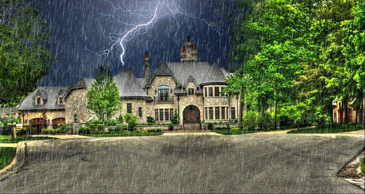 Yes this has been photoshopped. The rain is the only thing that's artificial. The House was shot in HDR, I masked out the original sky and layered in the lightning from a storm I shot from August, 2011. I found this to be rather an intriguing photo. It was a fun project, just something I wanted to do.