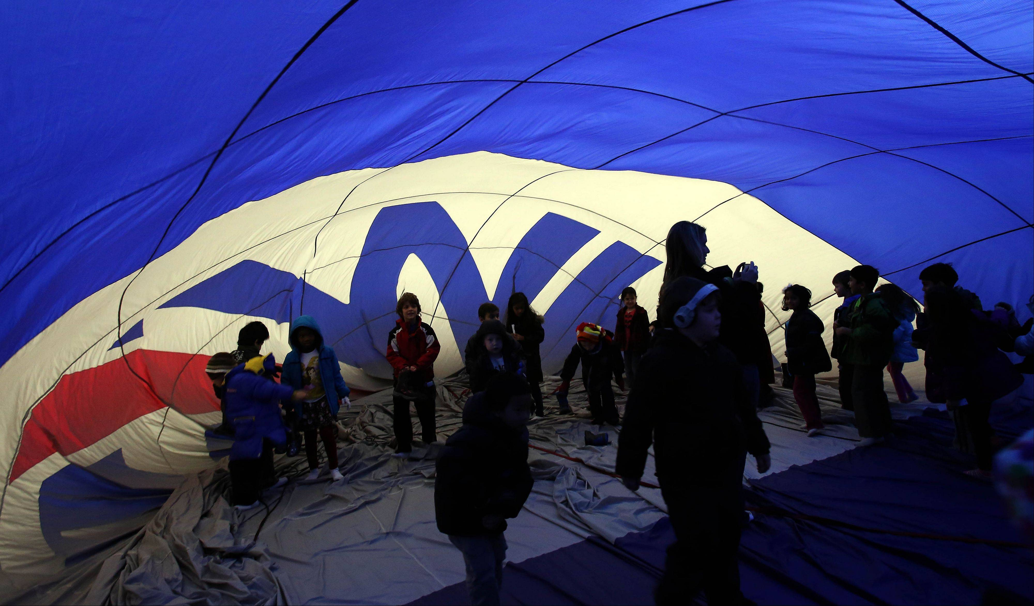 Students were able to walk around inside a partially inflated hot-air balloon Friday as a crew from RE/MAX visited Welch Elementary School in Naperville.