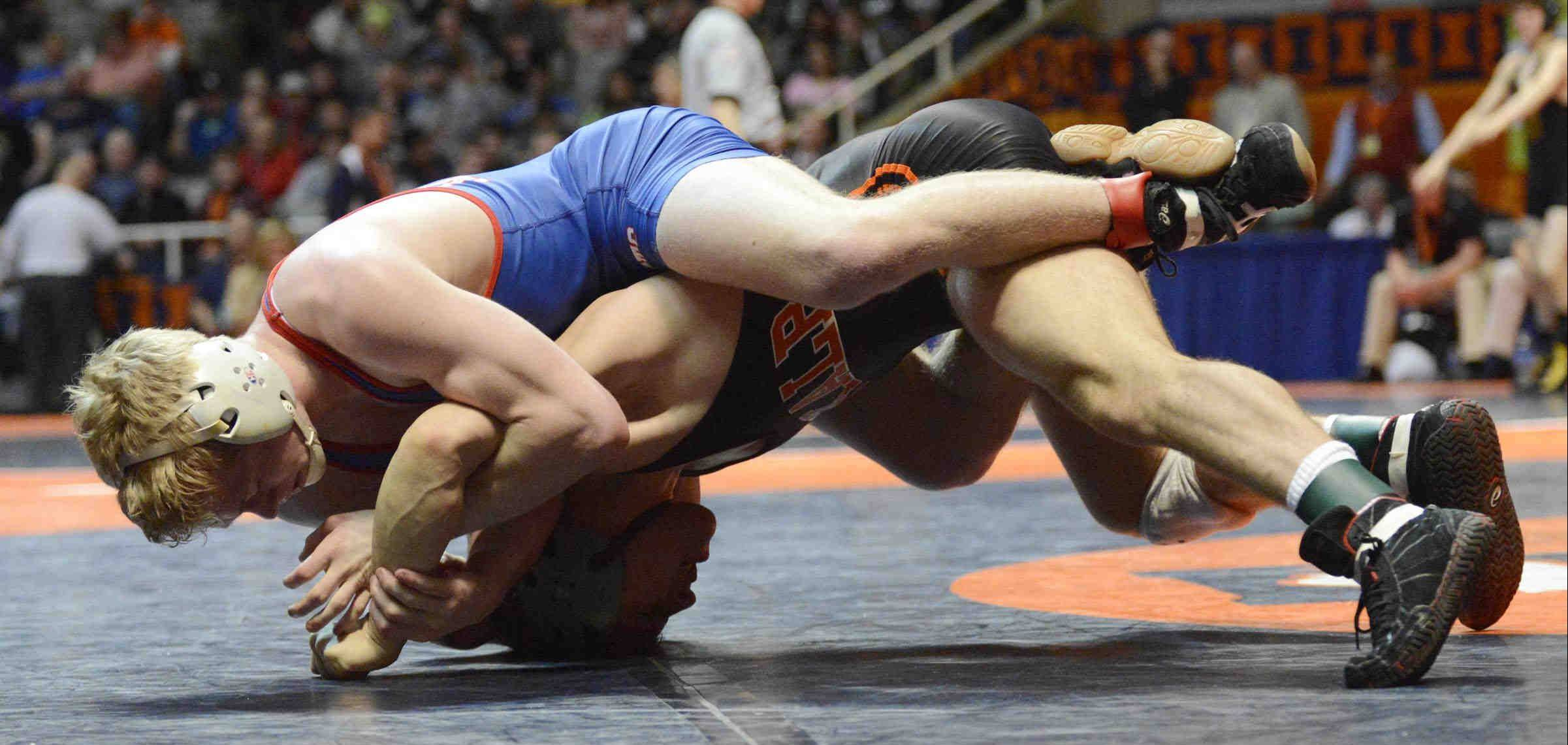 Marmion's George Fisher beats Doug Johnson of Dekalb Friday in the 132-pound Class 3A IHSA semifinal match in Champaign.