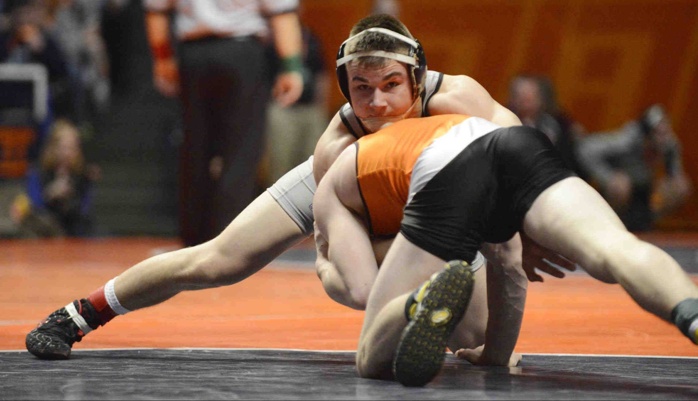 Kaneland's Dan Goress controls Chase Vosburgh of Mt. Vernon in the 145-pound Class 2A IHSA semifinal match Friday at Assembly Hall in Champaign.