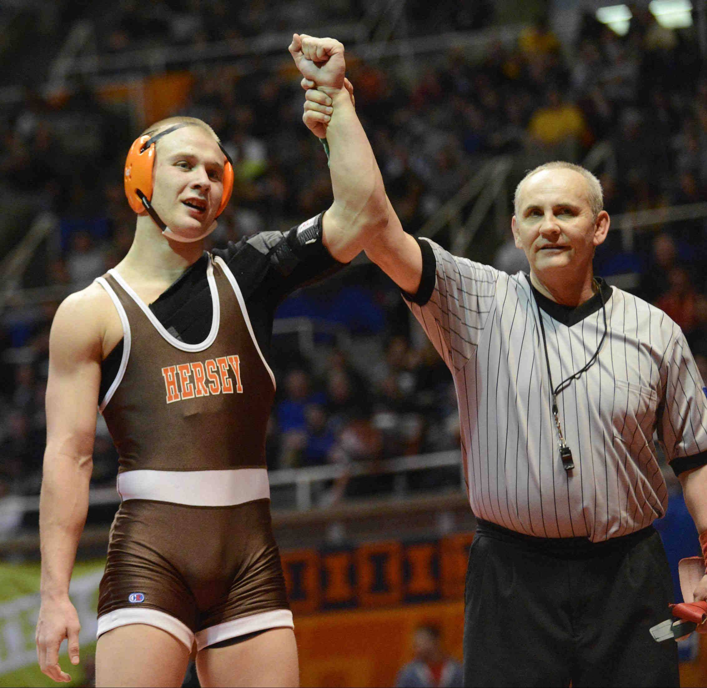 Hersey's Hunter Rollins is declared an 8-4 winner over Peter Andreotti of Marist in a 160-pound Class 3A semifinal Friday at Assembly Hall.